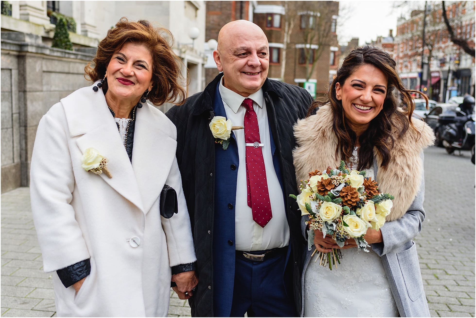 bride arrives outside islington town hall for her wedding