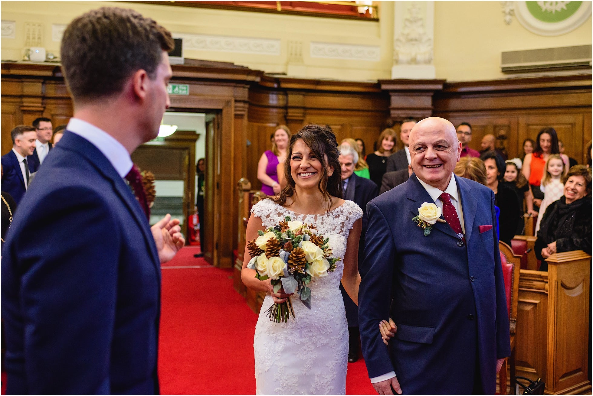 beaming bride and father of the bride at islington town hall