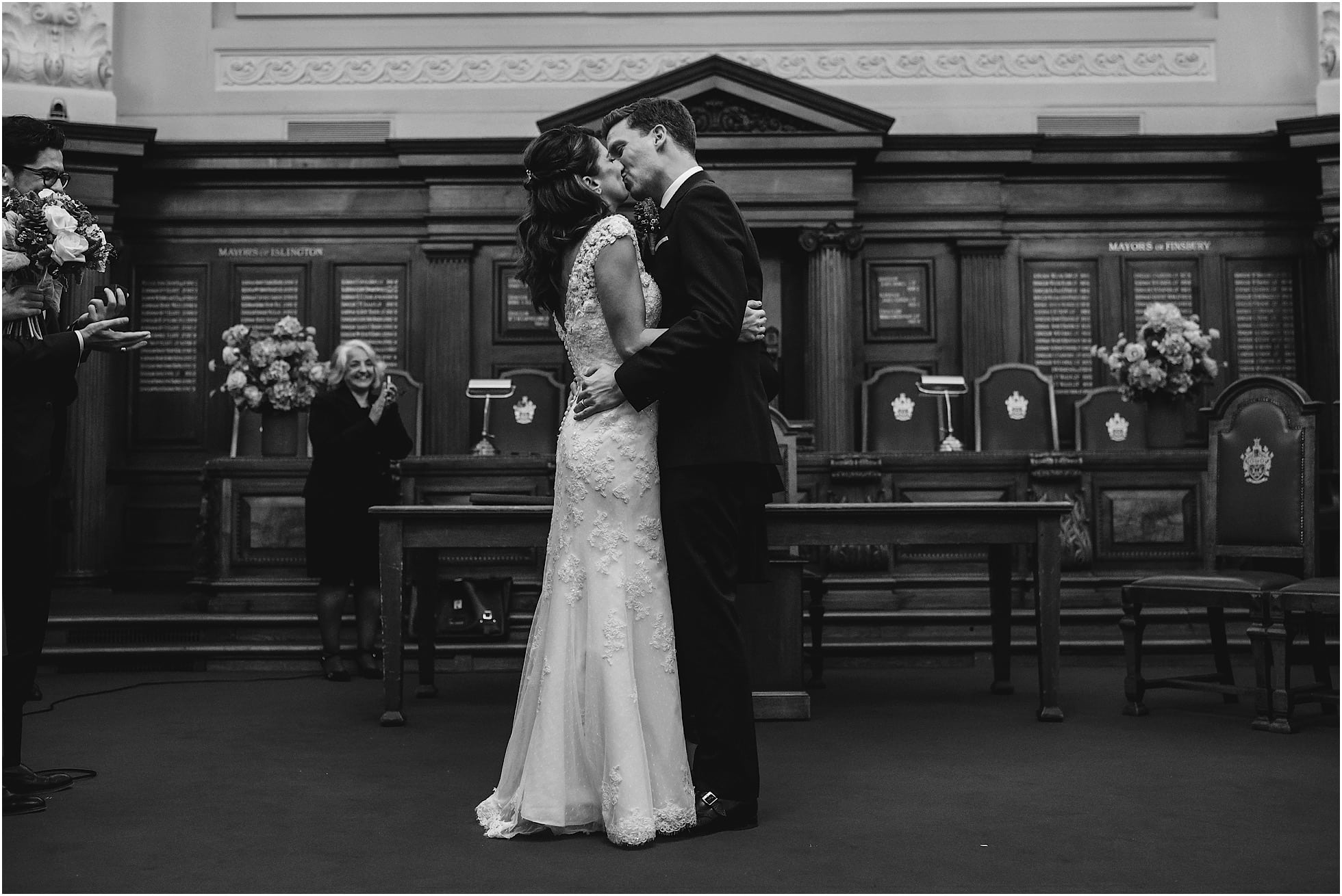 bride and groom first kiss at islington town hall
