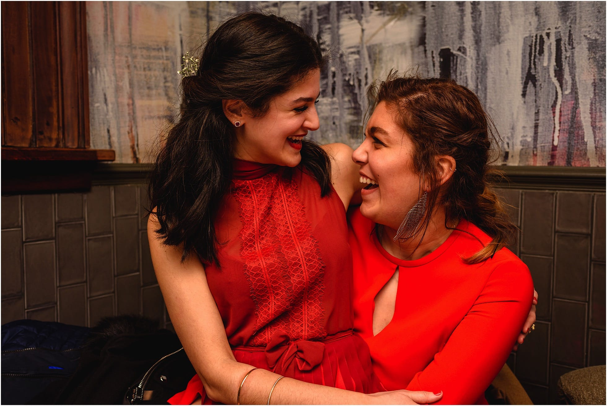 hugs and laughter from ladies in red