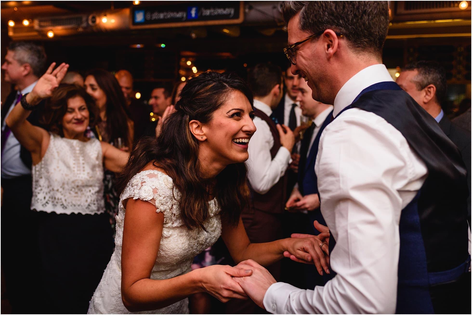 bride and groom dancing hand in hand