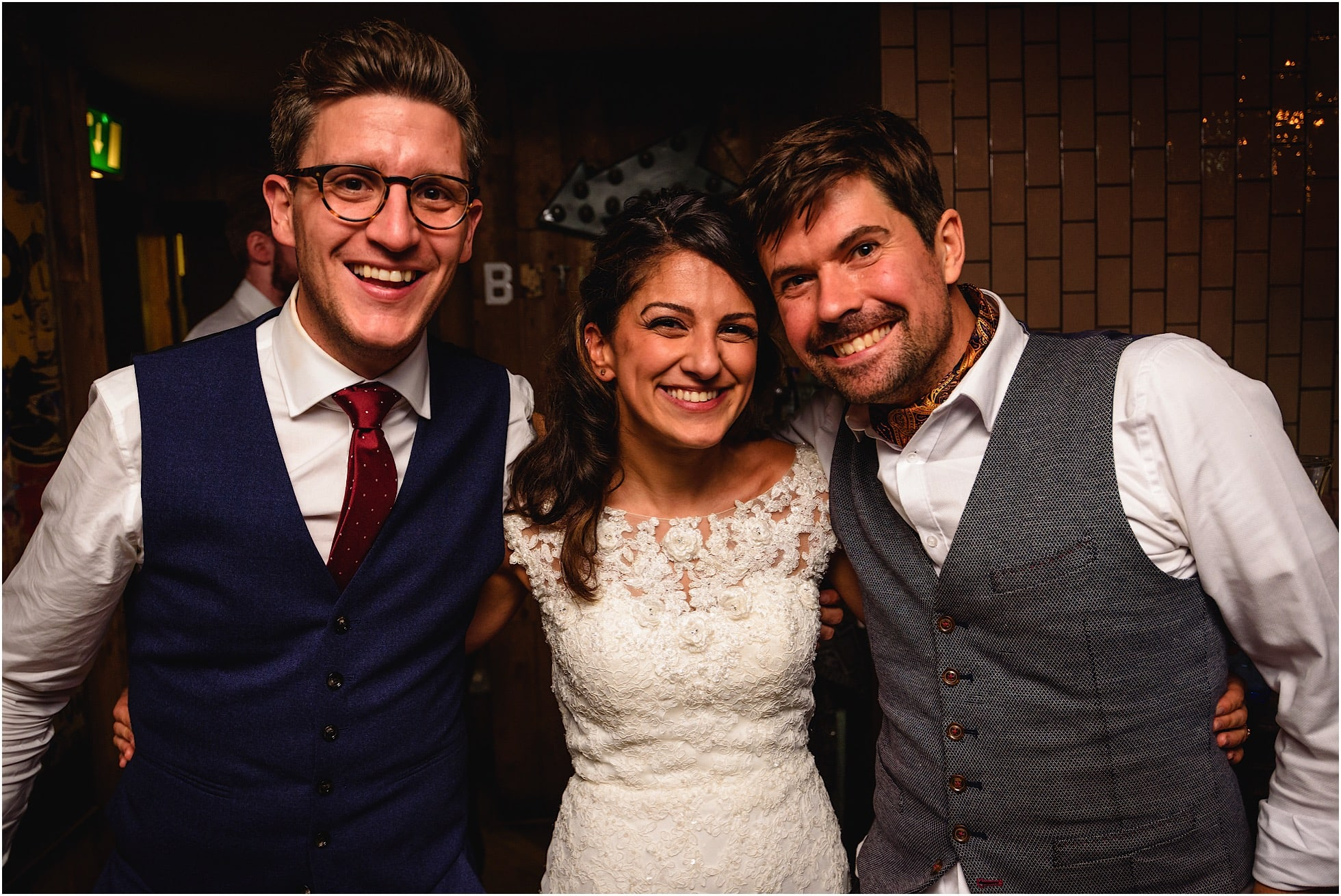 winston sanders with bride and groom lily and greg