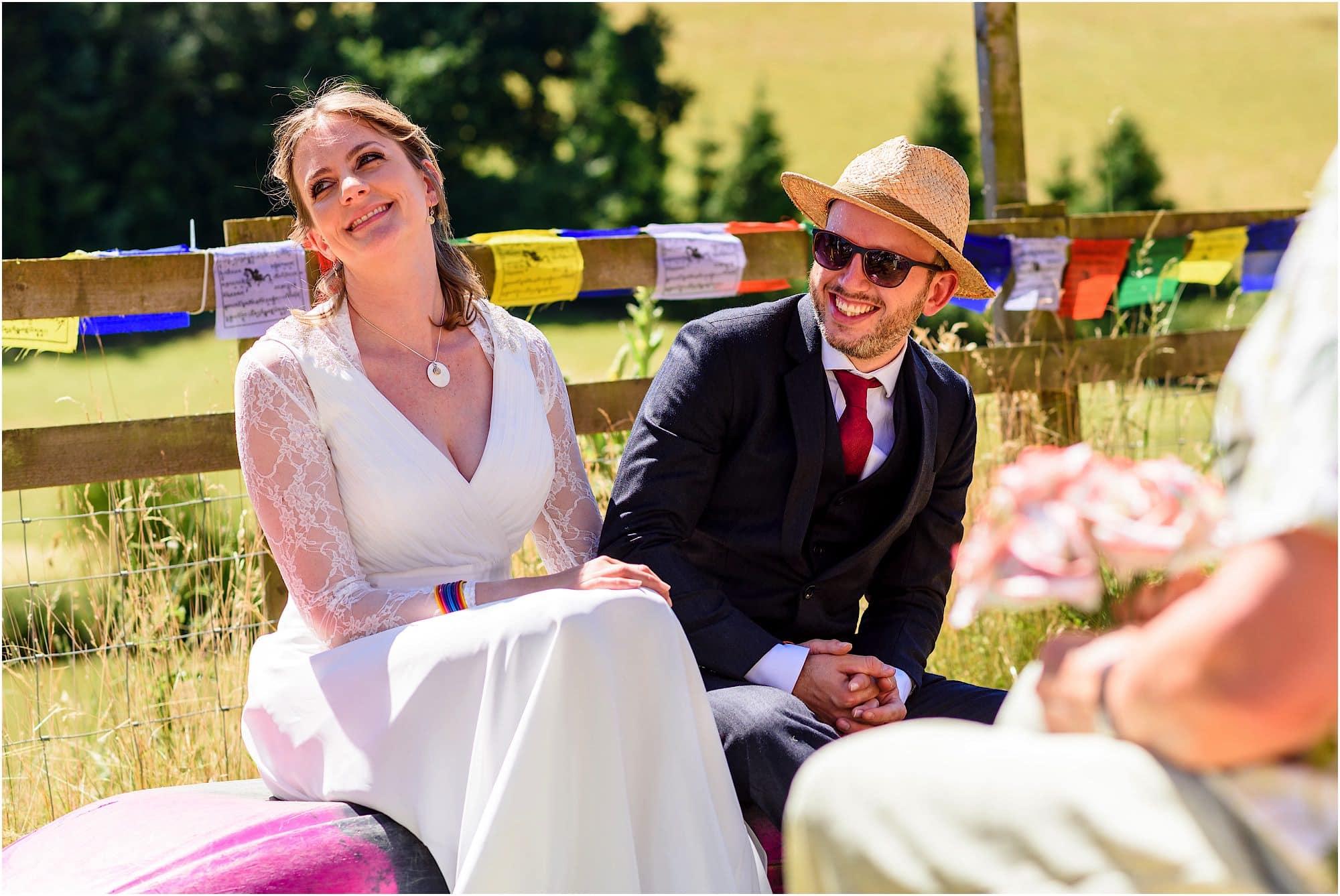 bride and groom sat on kayak