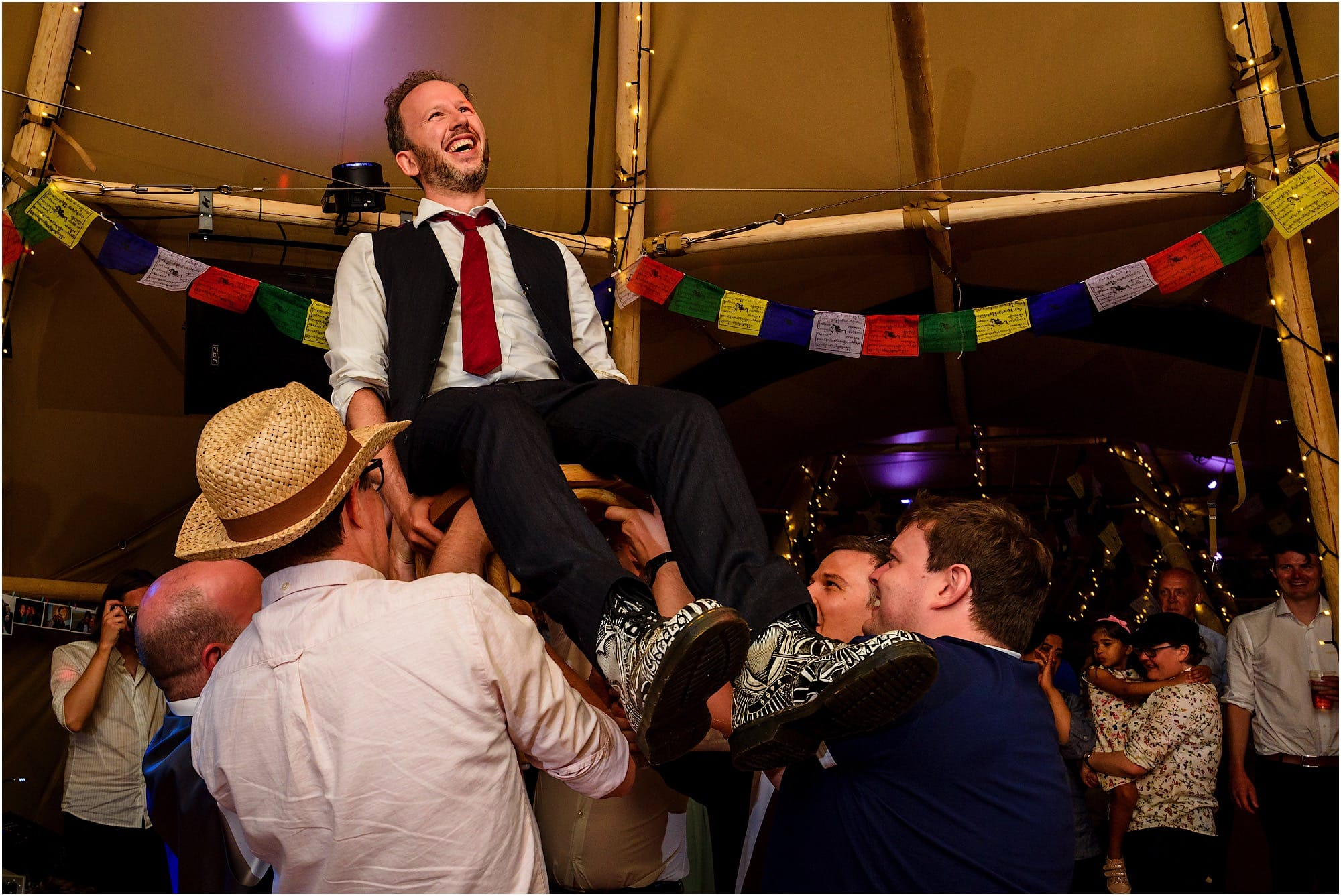 lifting up the groom
