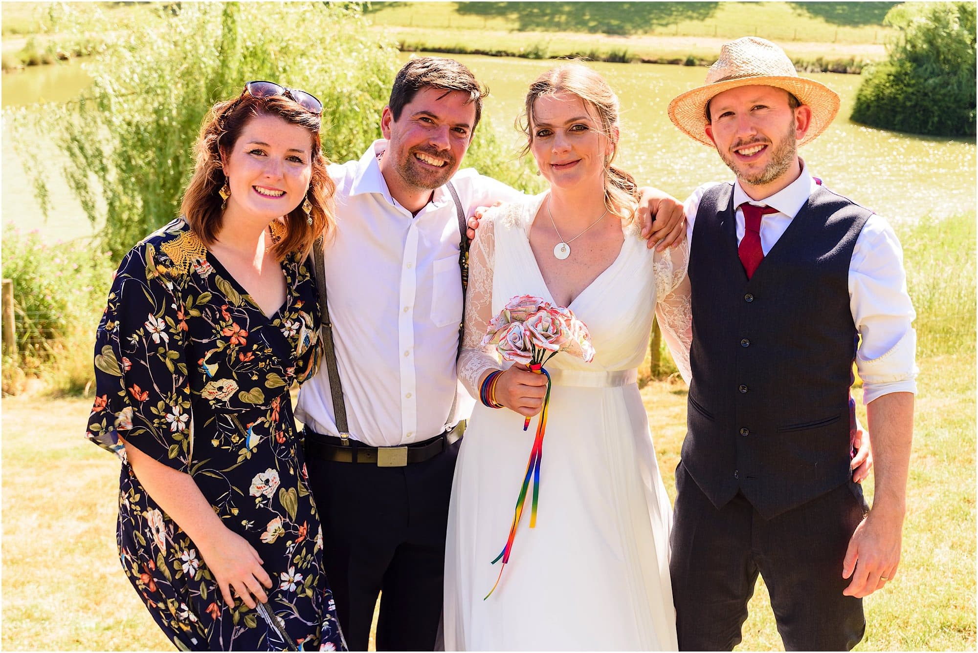 wedding photographer with bride, groom and wife