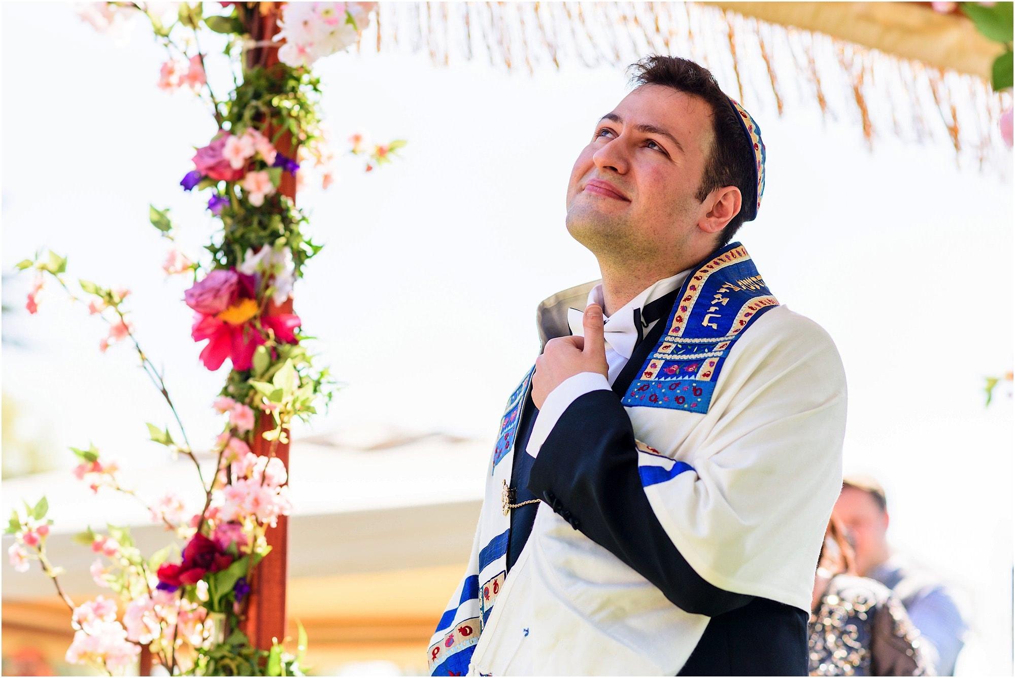 groom under the chuppah