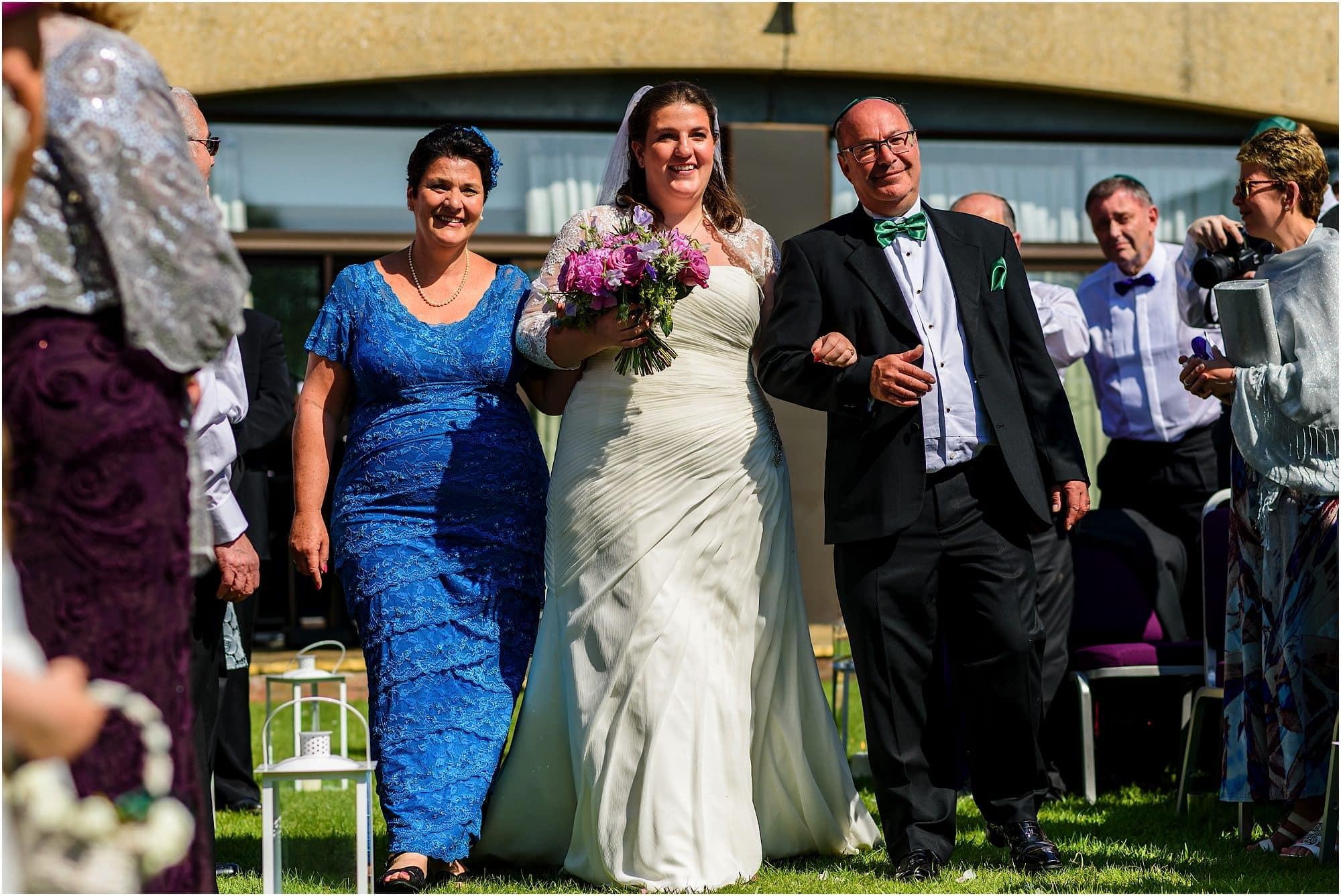 bride walks down aisle at doubletree by hilton cambridge