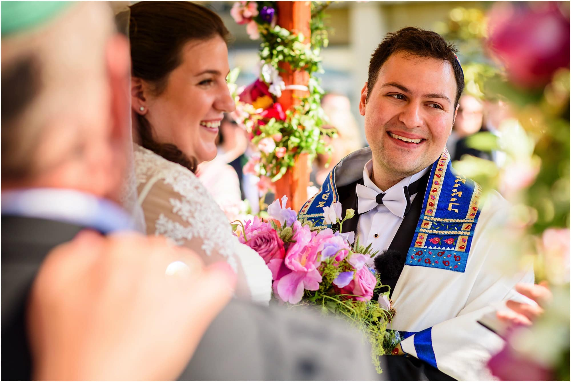 happy bride and groom under the chuppah