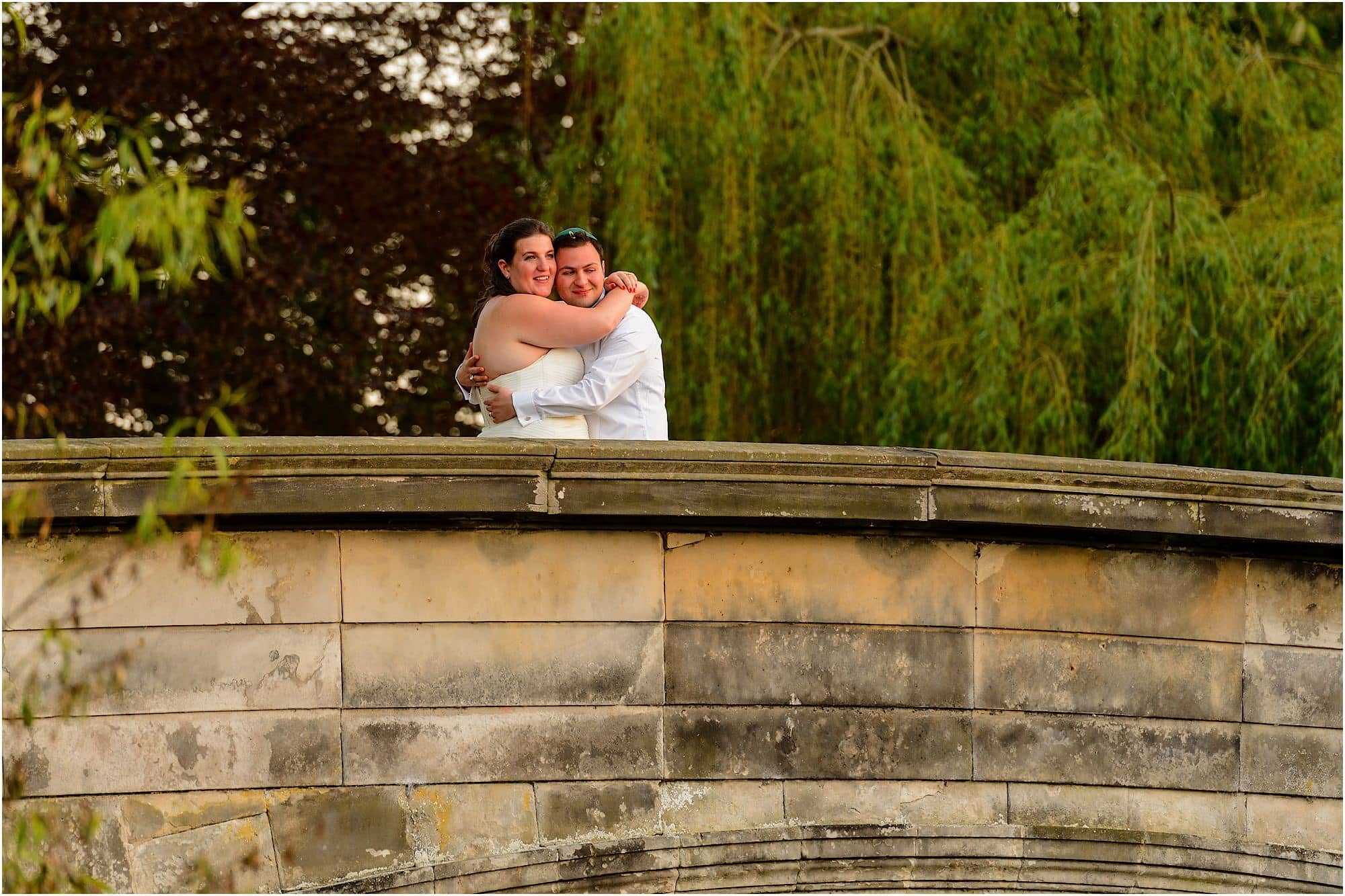 cuddle on the bridge over the river Cam