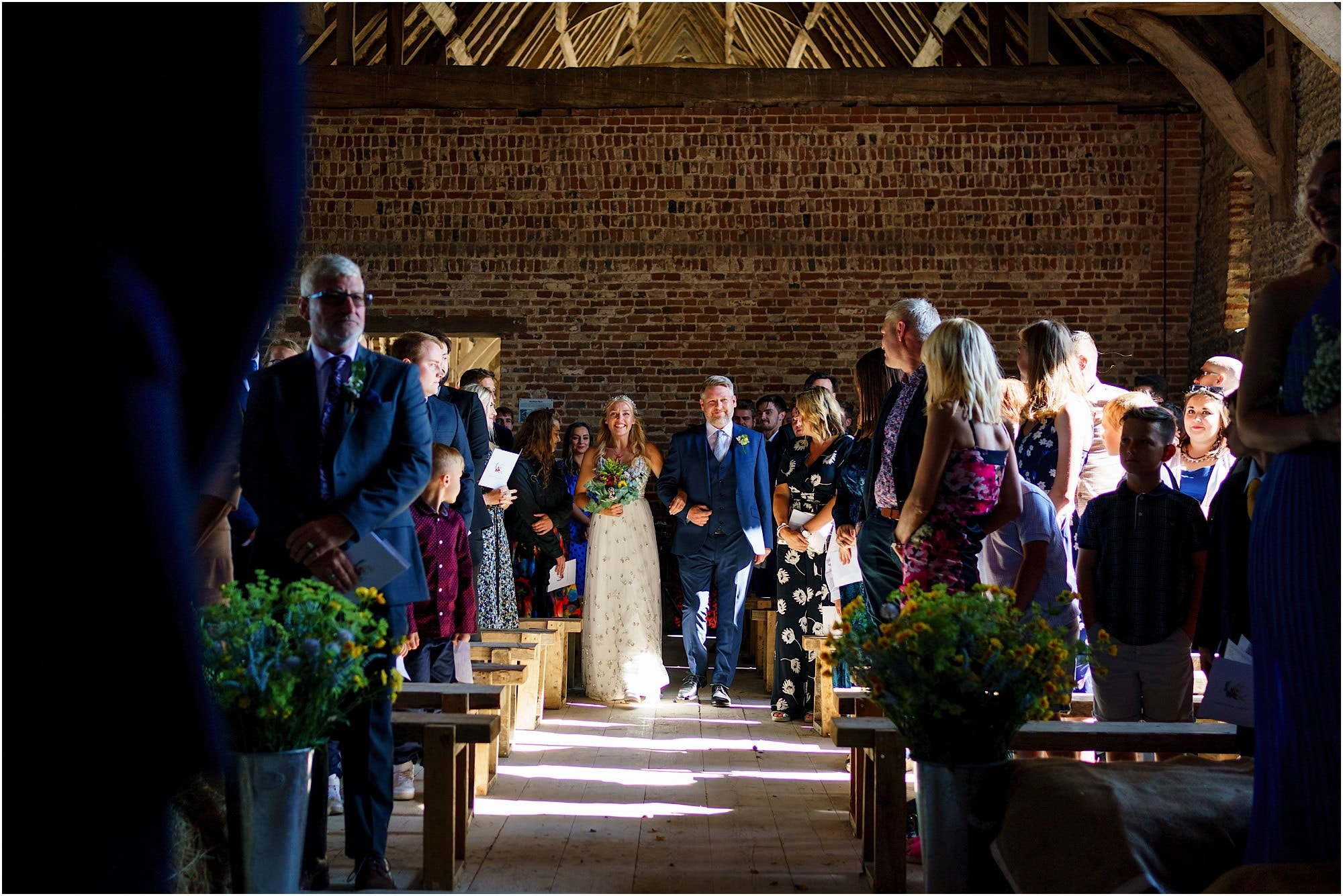 Father of bride and bride walking down the aisle
