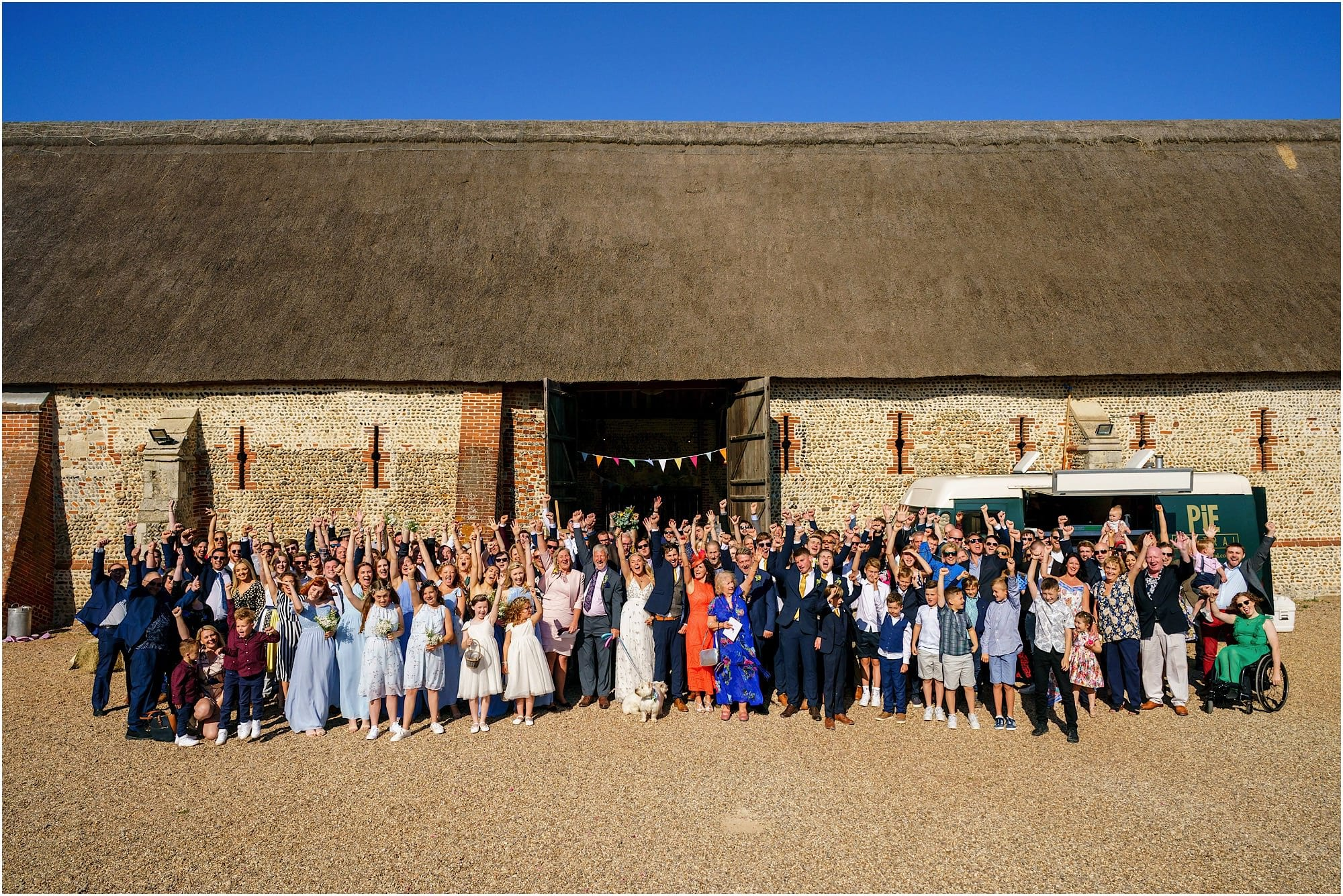 wedding at Waxham Great Barn large group photo