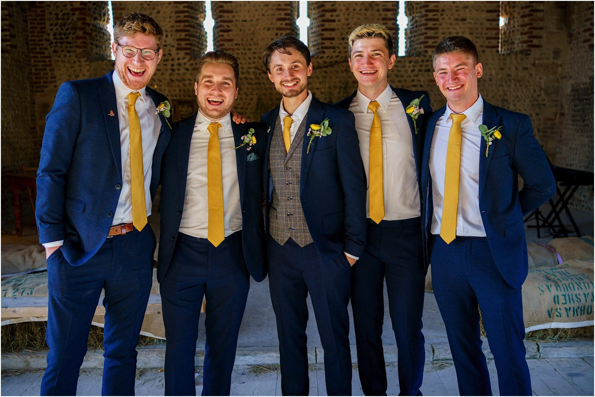 groomsman group shot in the barn