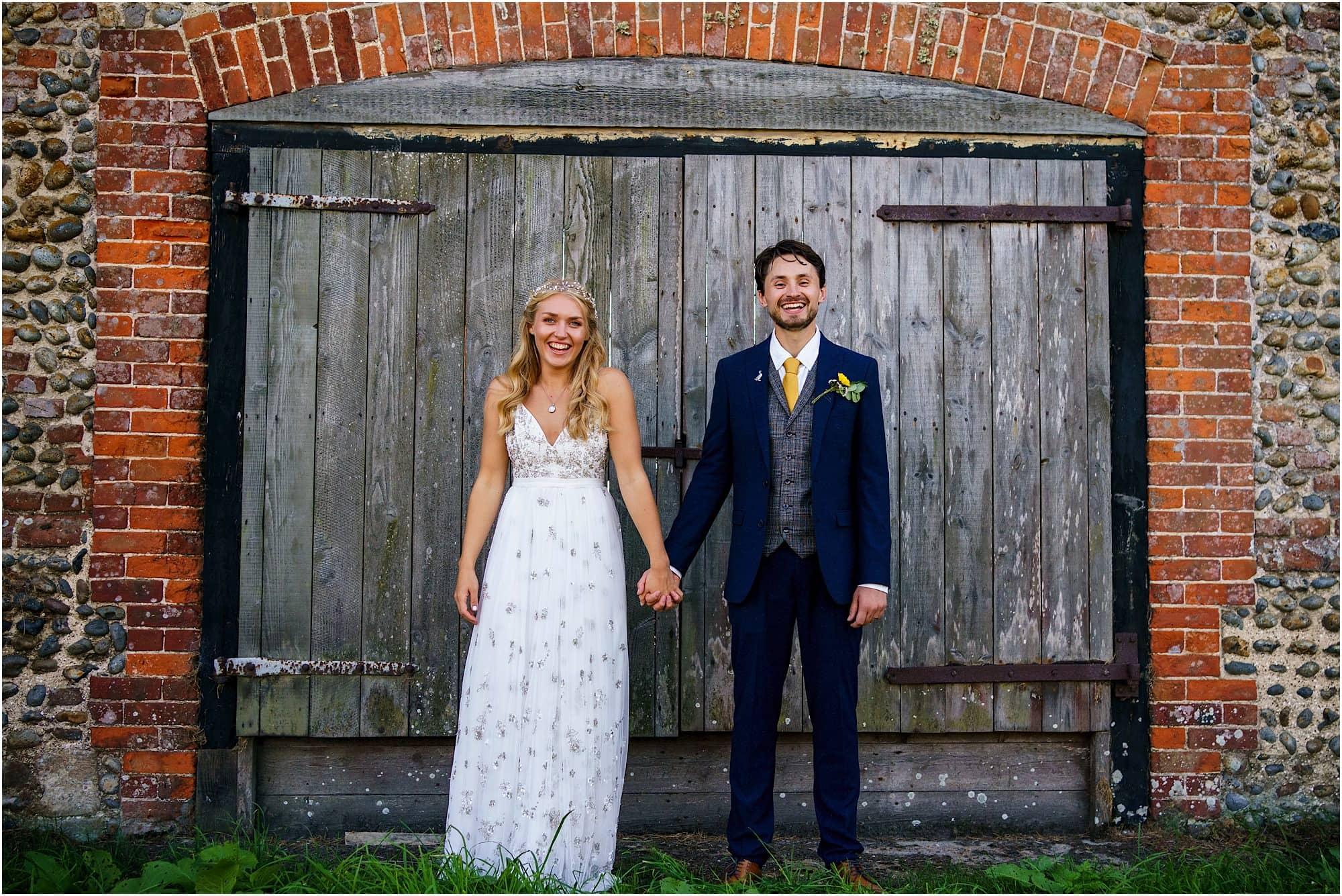 couple portrait of bride and groom at Waxham Great Barn doors
