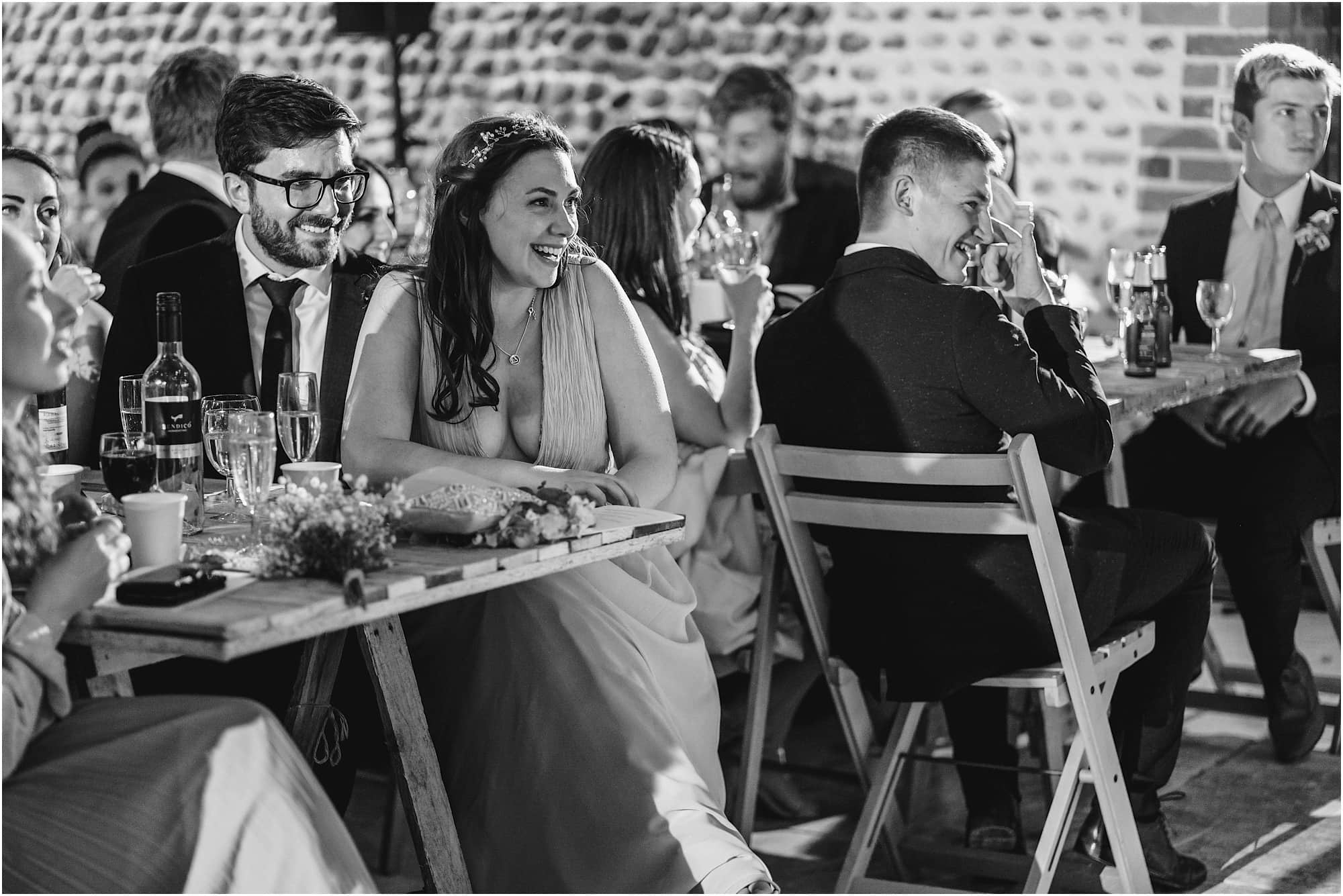laughing guests during speeches in the Norfolk barn