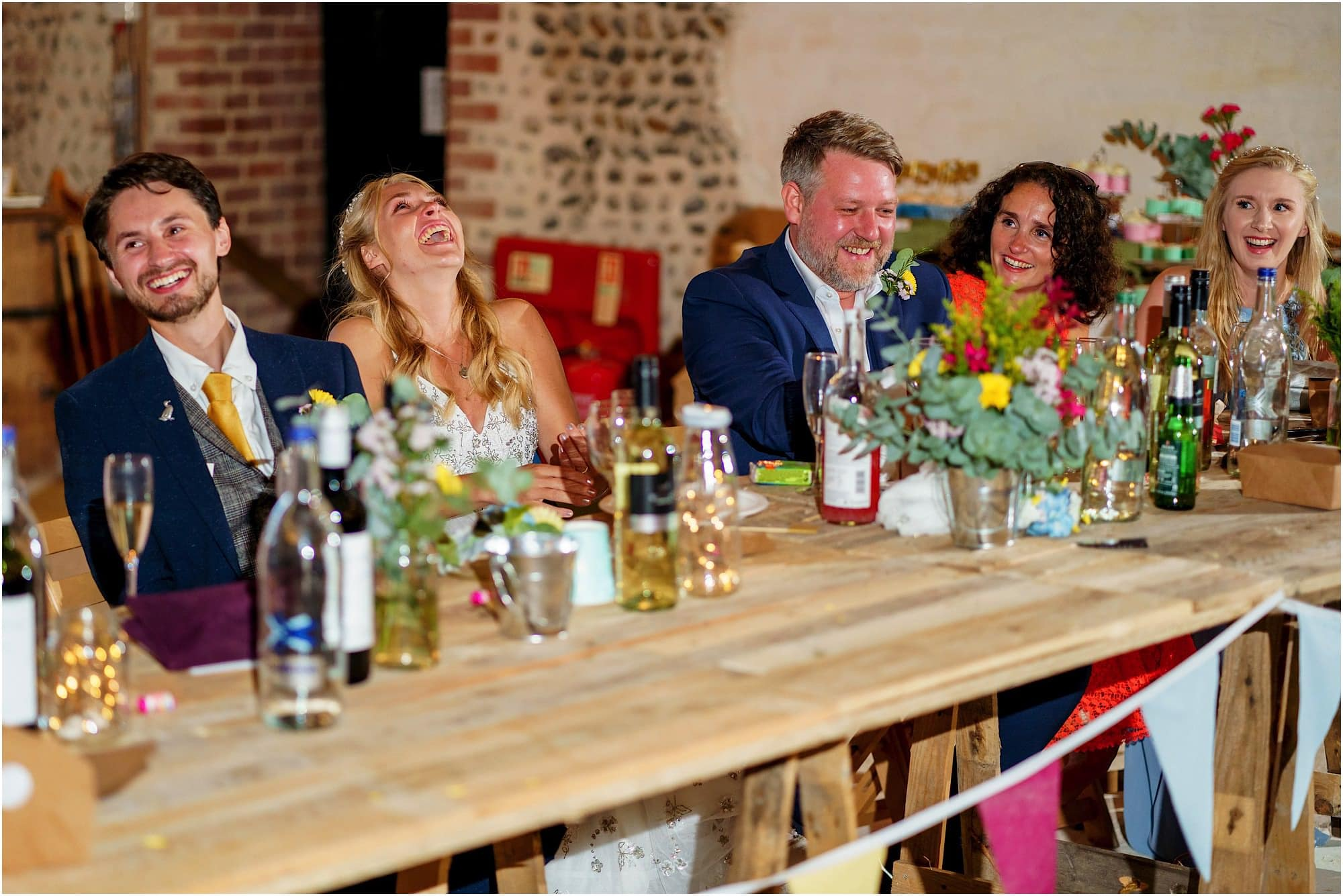 laughter at the top table during best mans speech