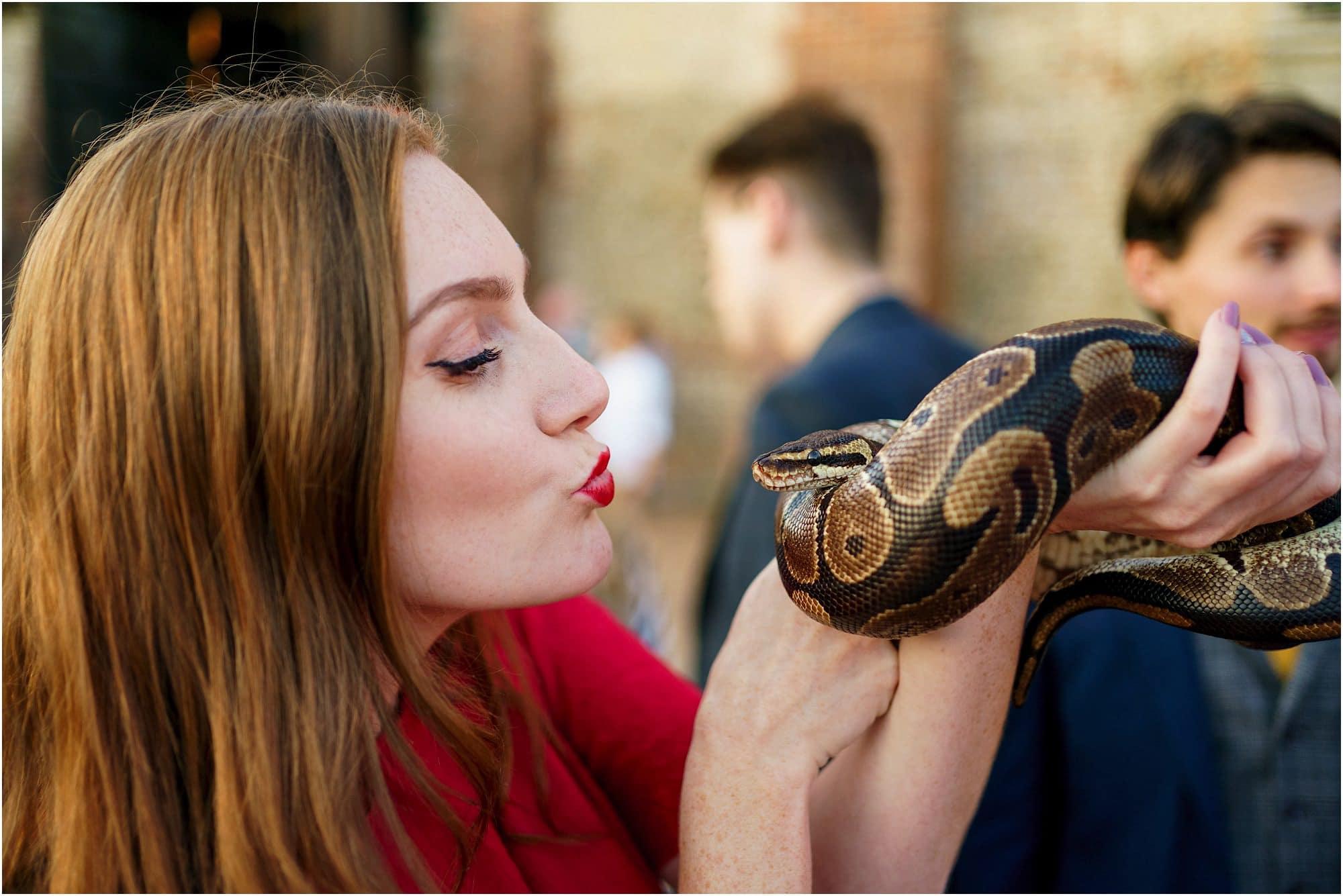 lady kissing a snake