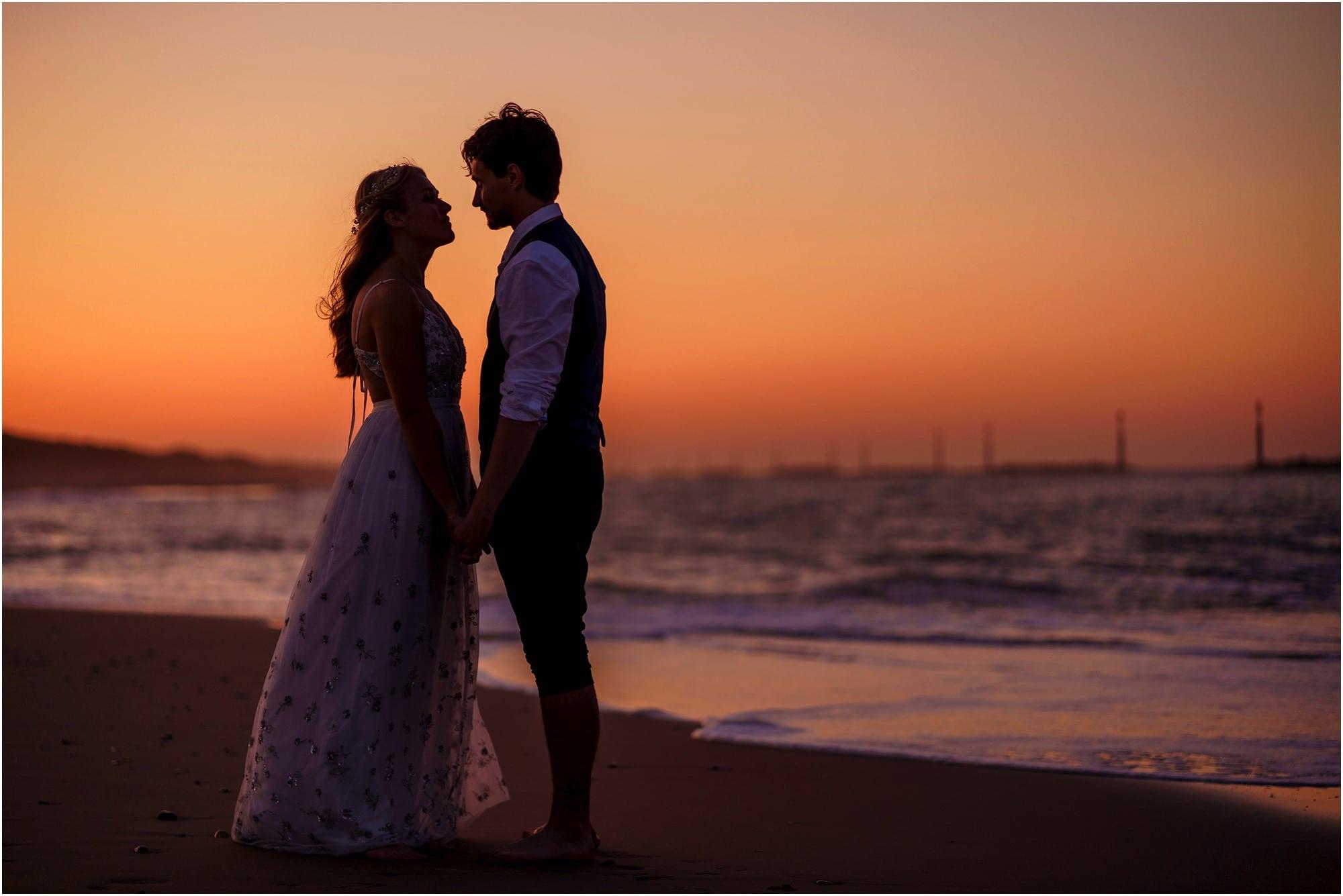 romantic wedding on the beach at sunset