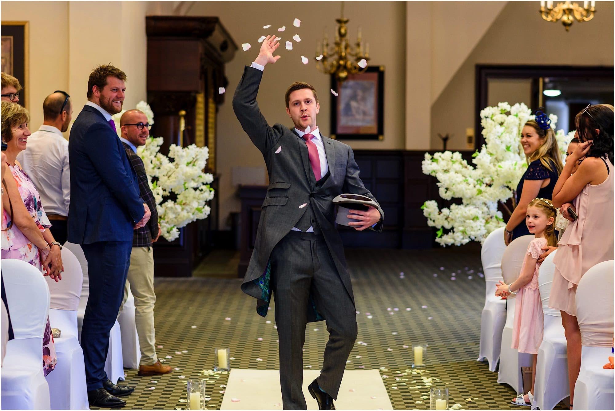 confetti throwing groomsman
