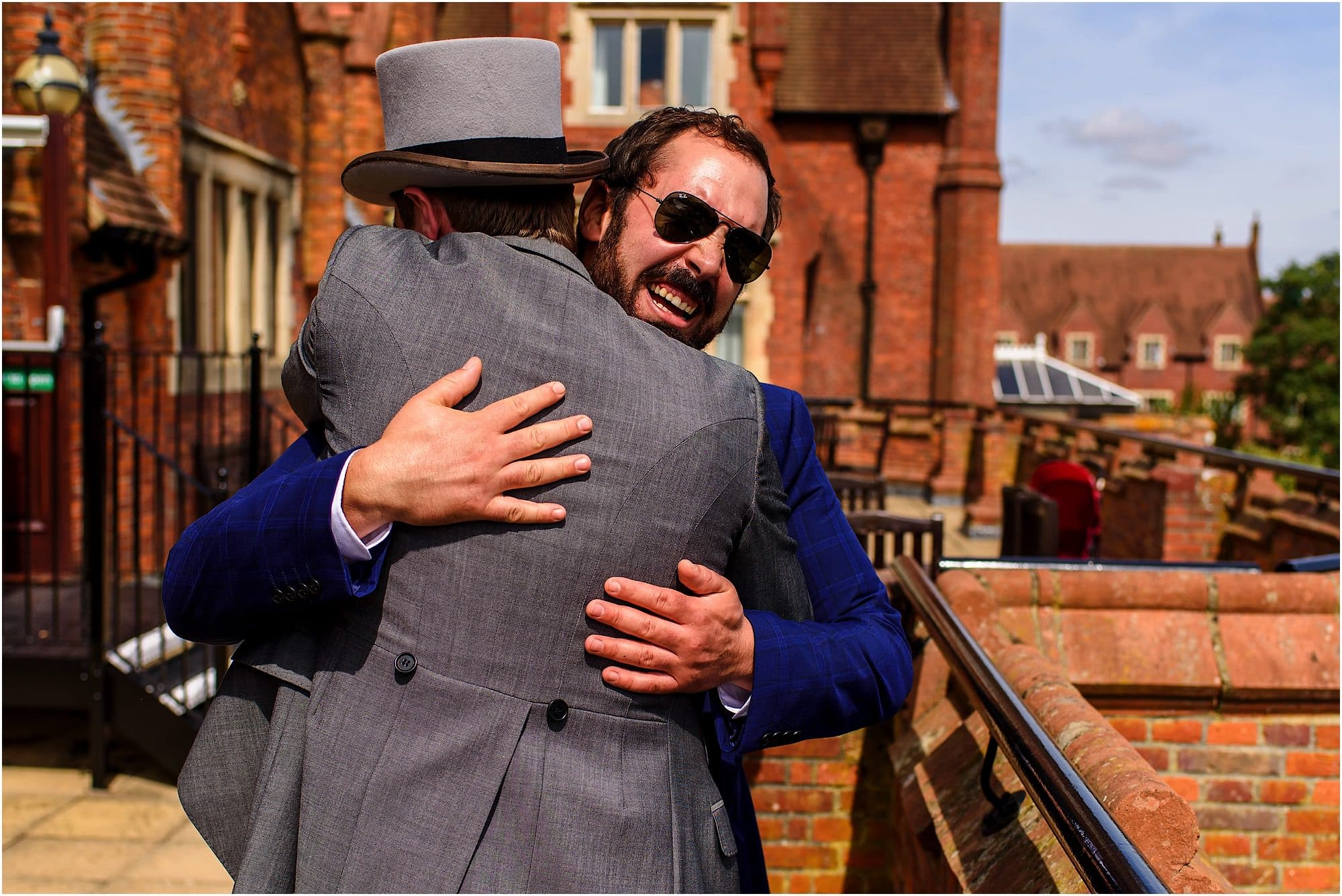 Natural wedding photography guest hugs