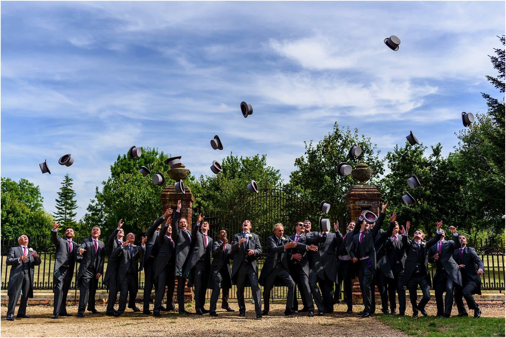 Groomsmen throwing the hats
