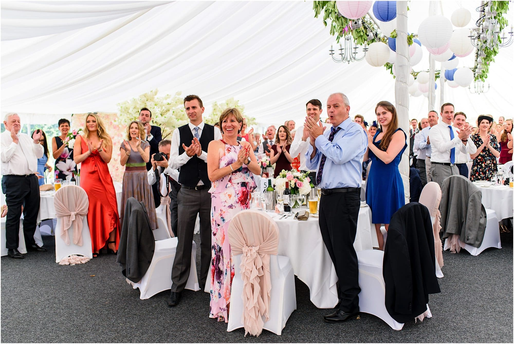 Guests welcoming the bride and groom