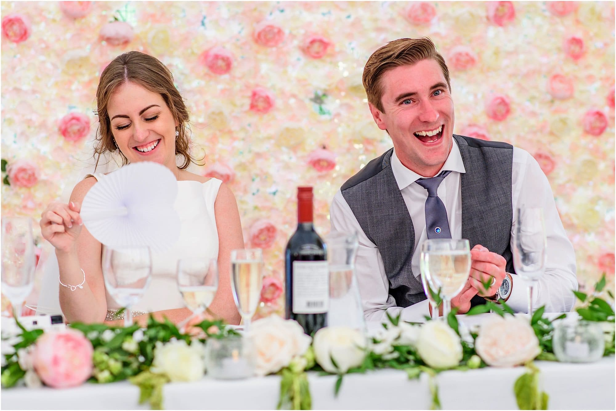 laughter at the top table during father of the groom speech