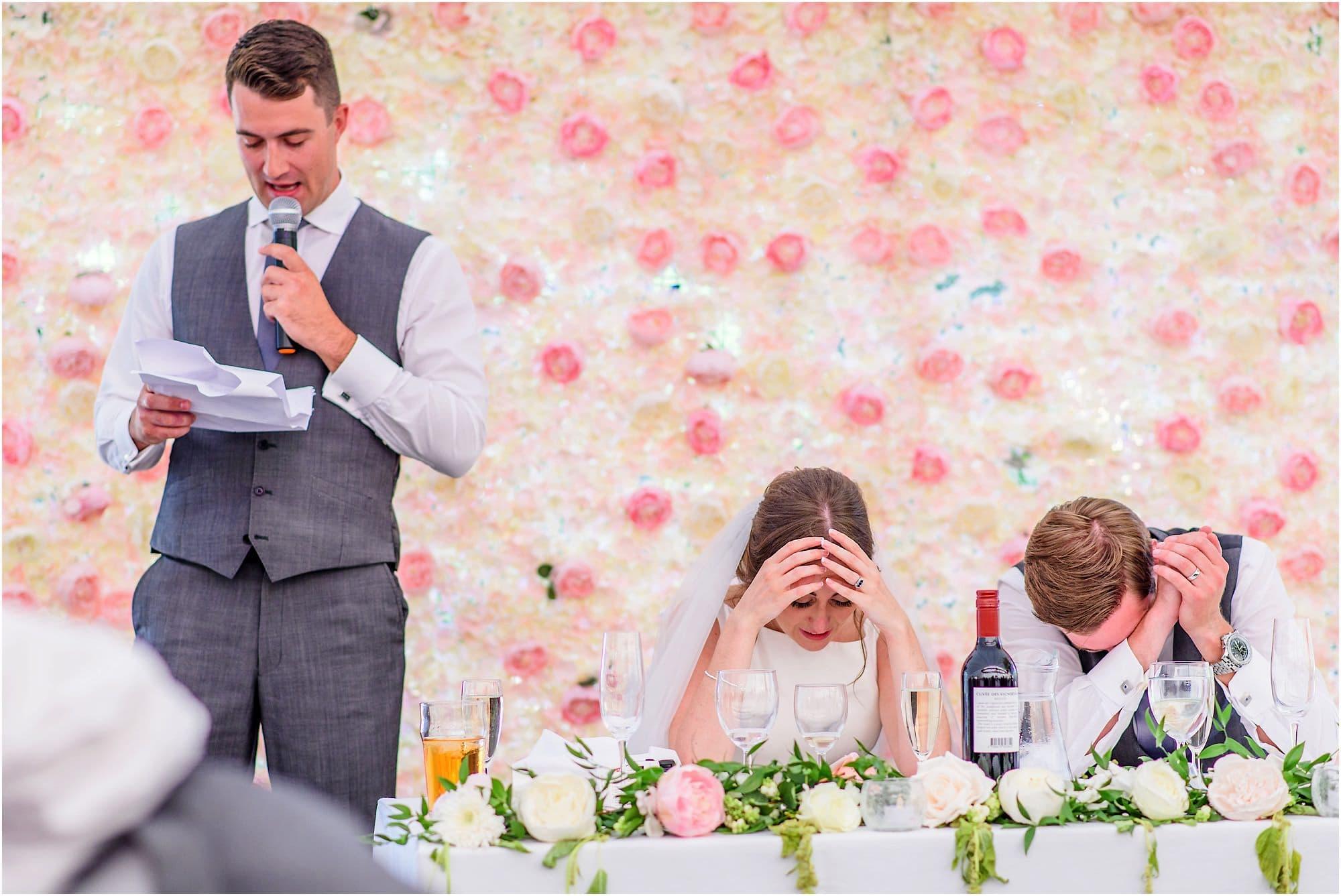 embarrassed couple during best man's speech