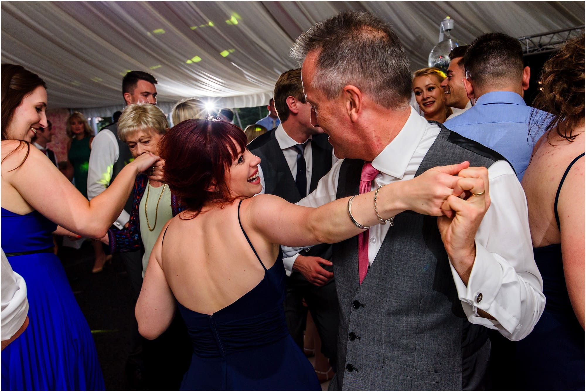 bridesmaid and her dad dancing