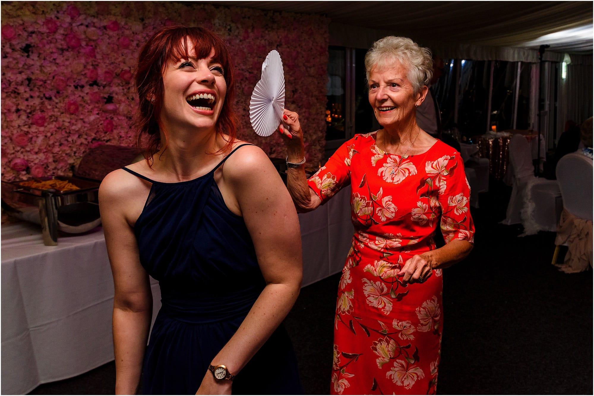 gran fanning the bridesmaid