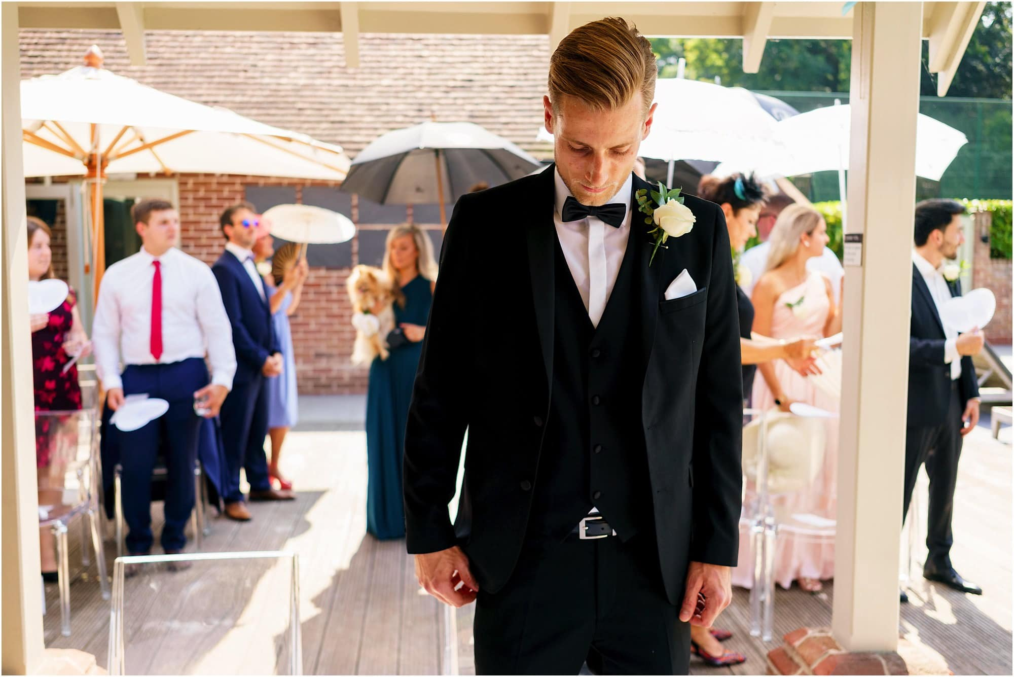 groom anxiously waits for bride at the alter