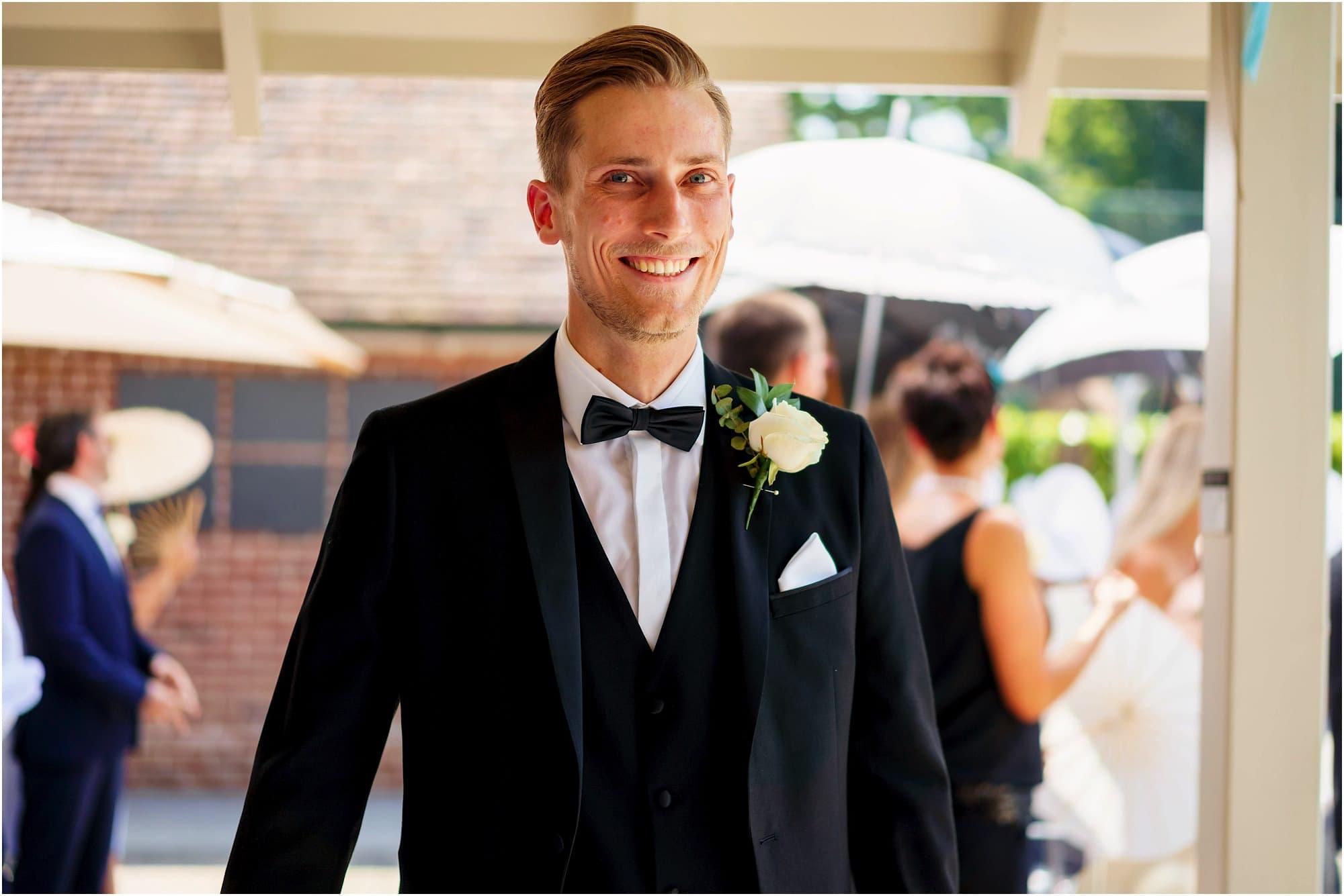 happy groom by poolside