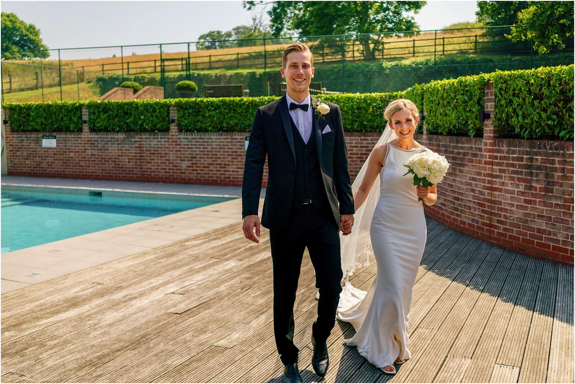 bride and groom leave the pool house