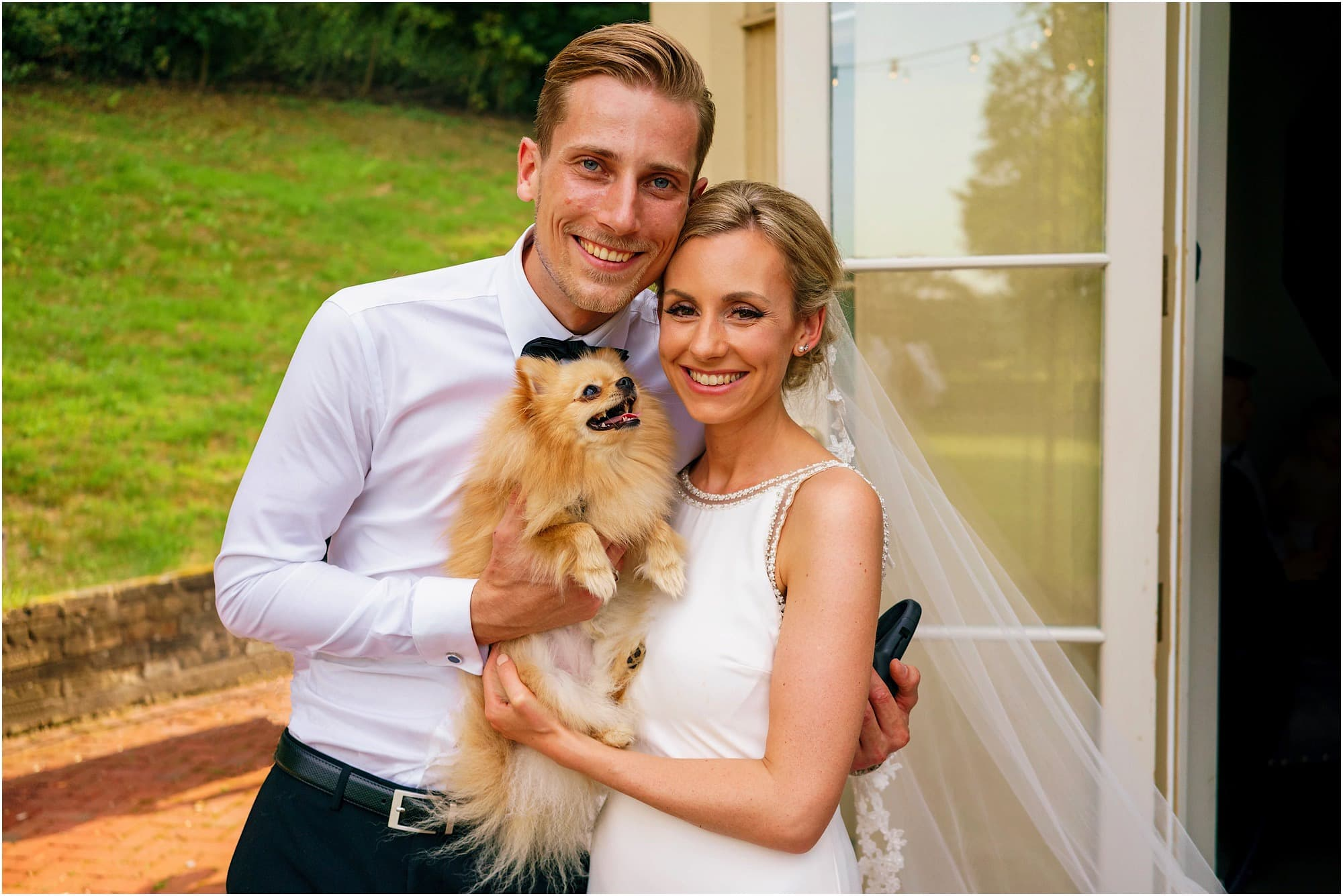 Bride and Groom with their dog photo