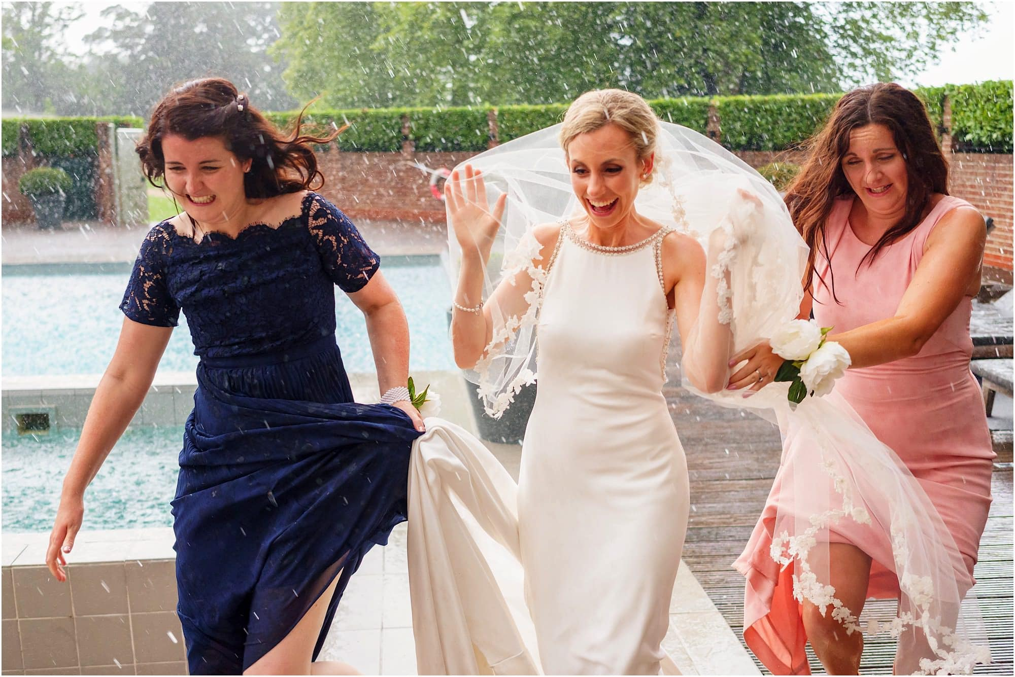bride and bridesmaids running in the rain!