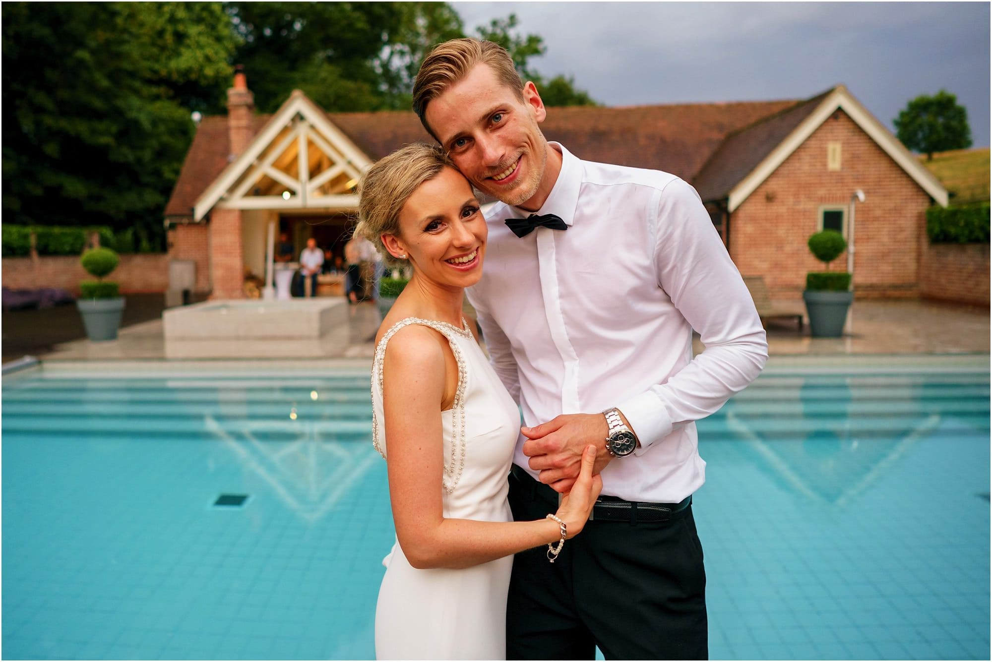 bride and groom by the pool on the hottest day of the year