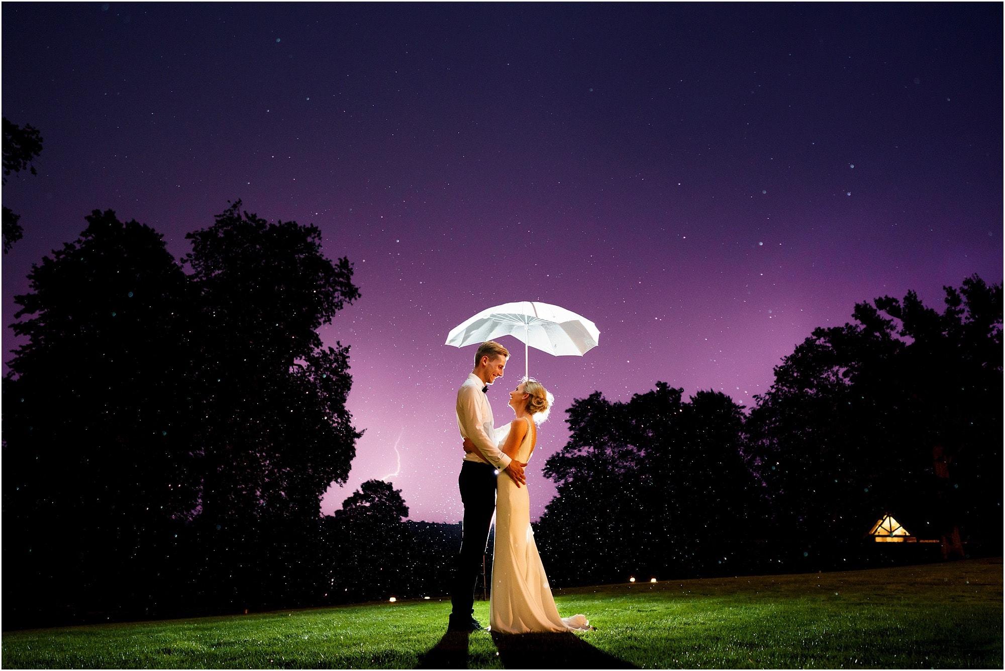 epic lightning wedding photo by a Maison Talbooth Wedding Photographer