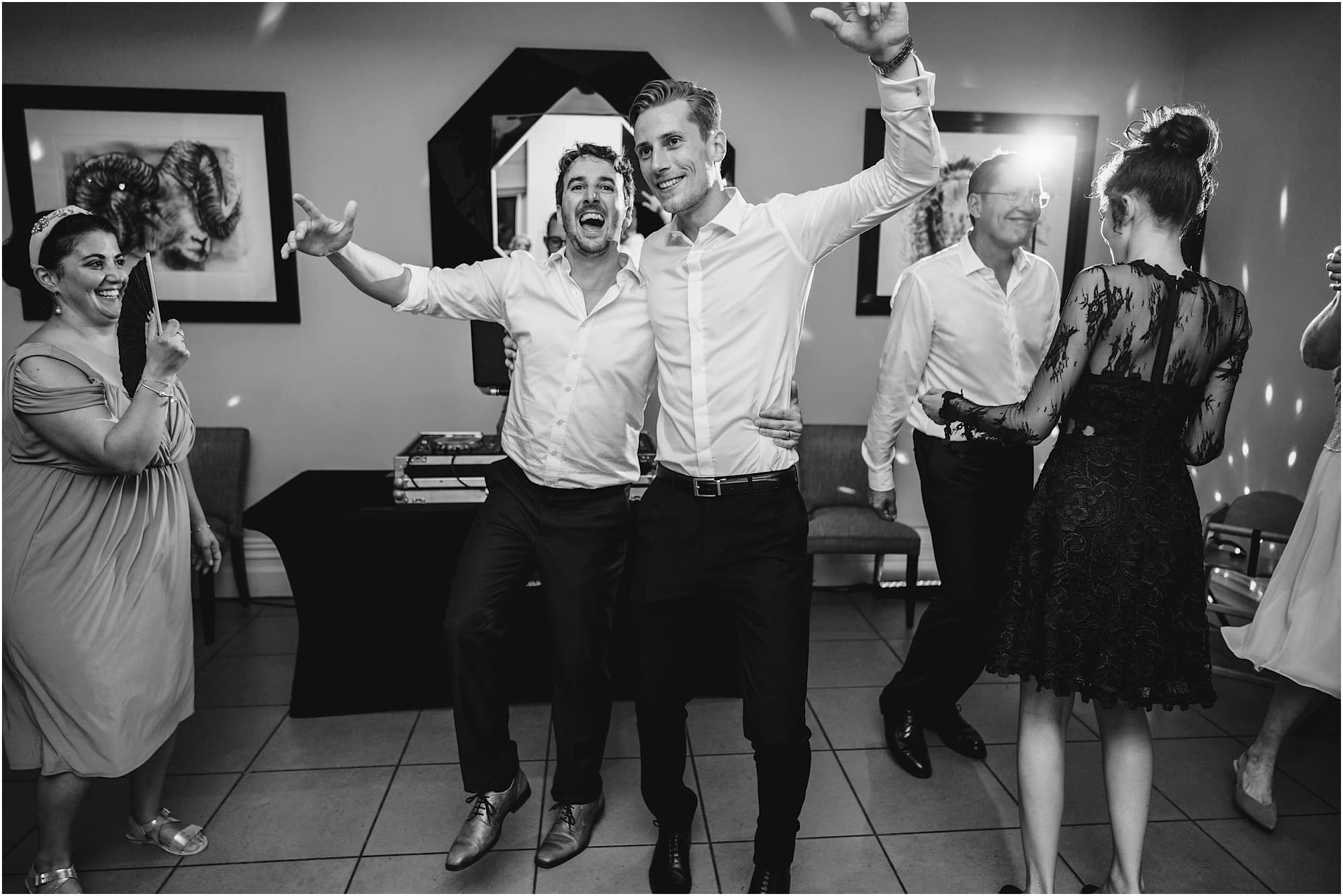 groom dancing with his friends