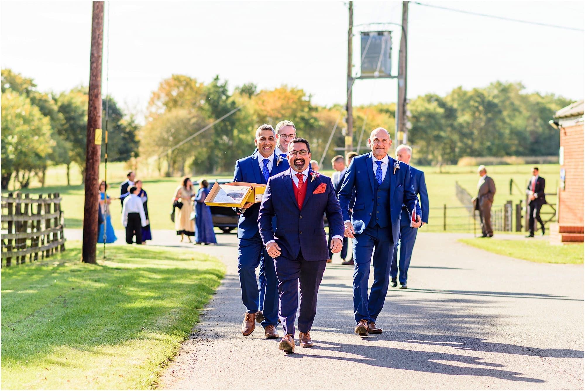 Groomsmen walking to Childerley Hall