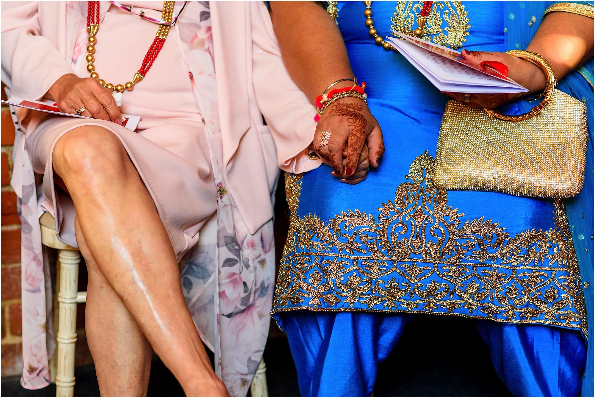 Mothers holding hands