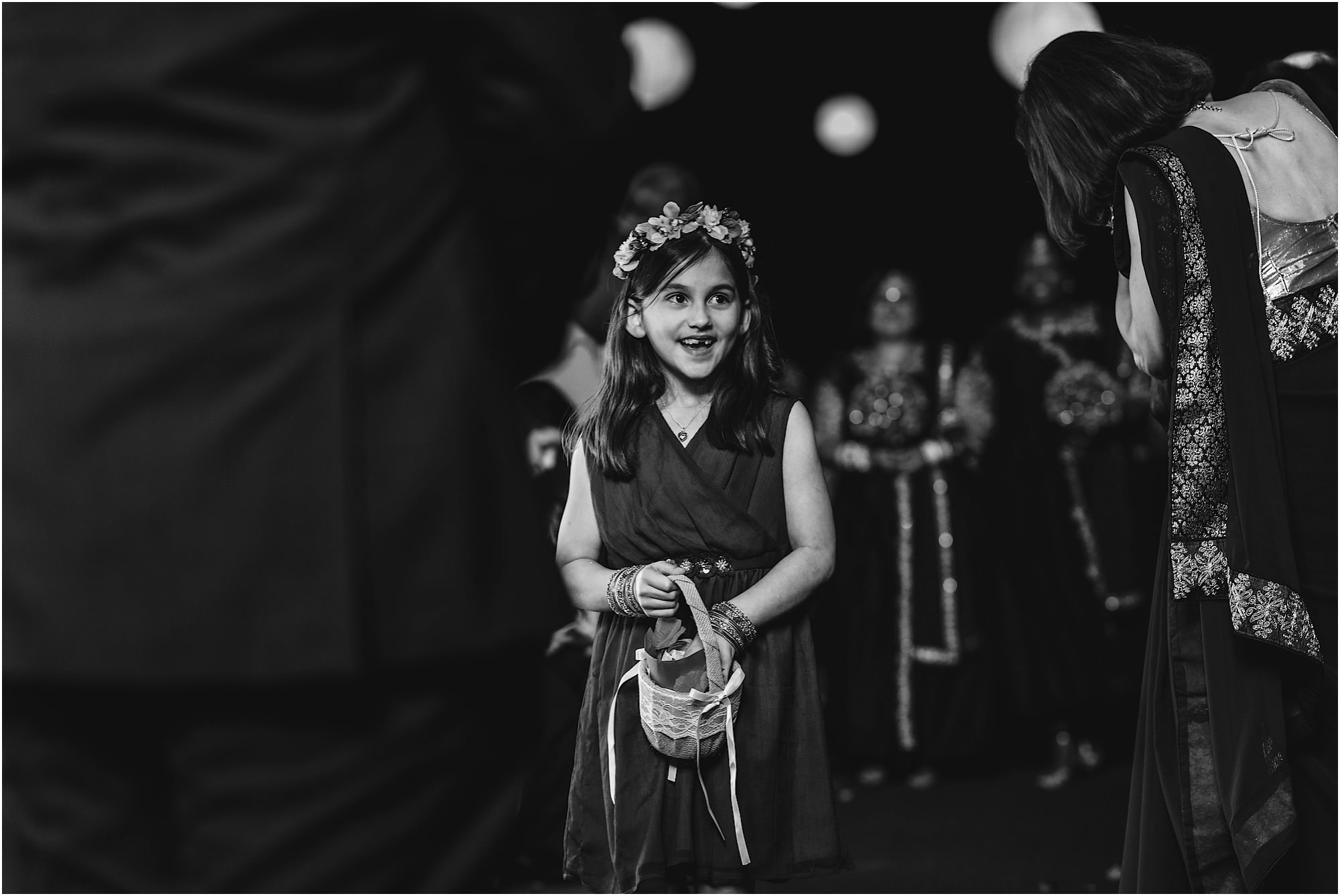 Black and white photo of flowergirl