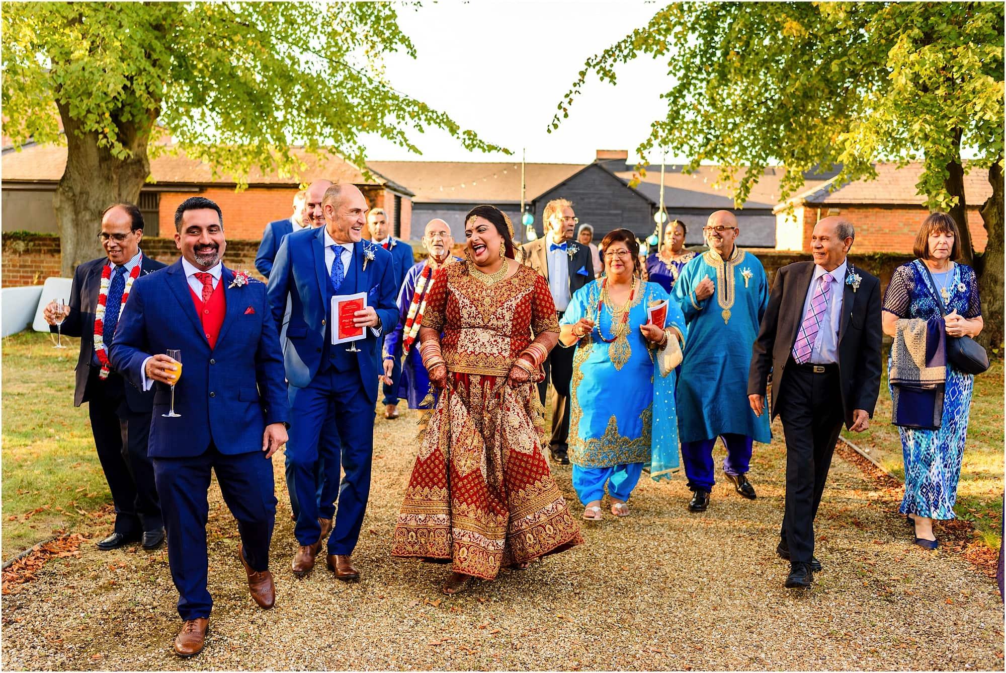 Candid walking shot of wedding party