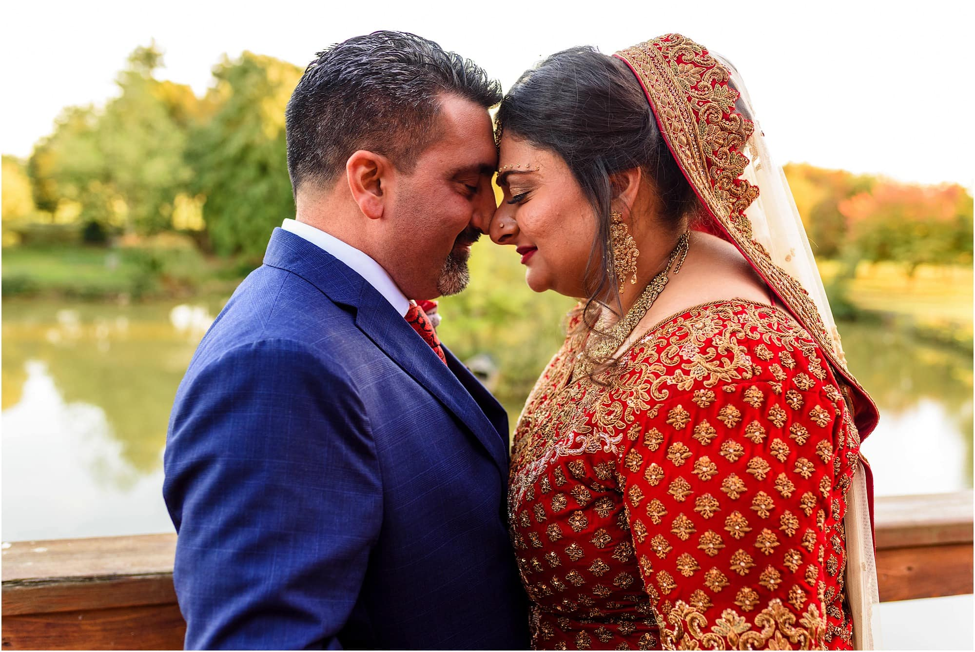Eskimo kiss at Childerley Hall Cambridge Wedding