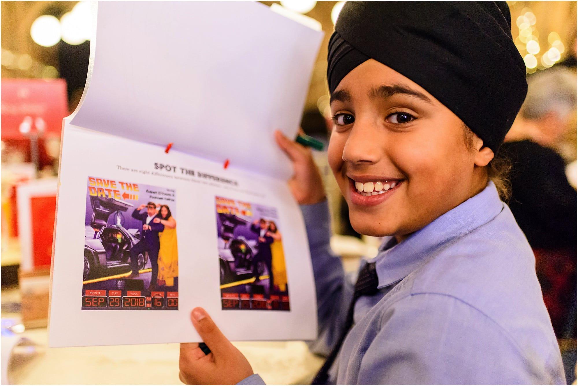 Kid in turban happy with his menu