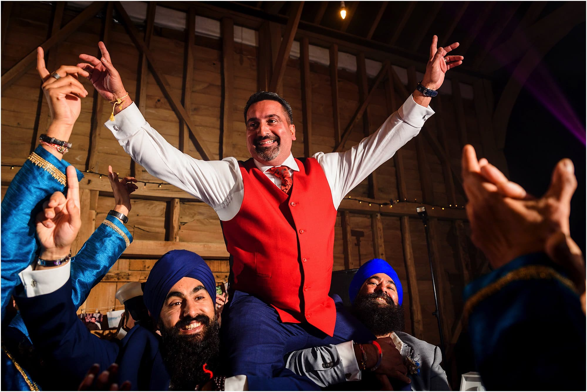 Groom lifted up on shoulders, having the time of his life at Childerley