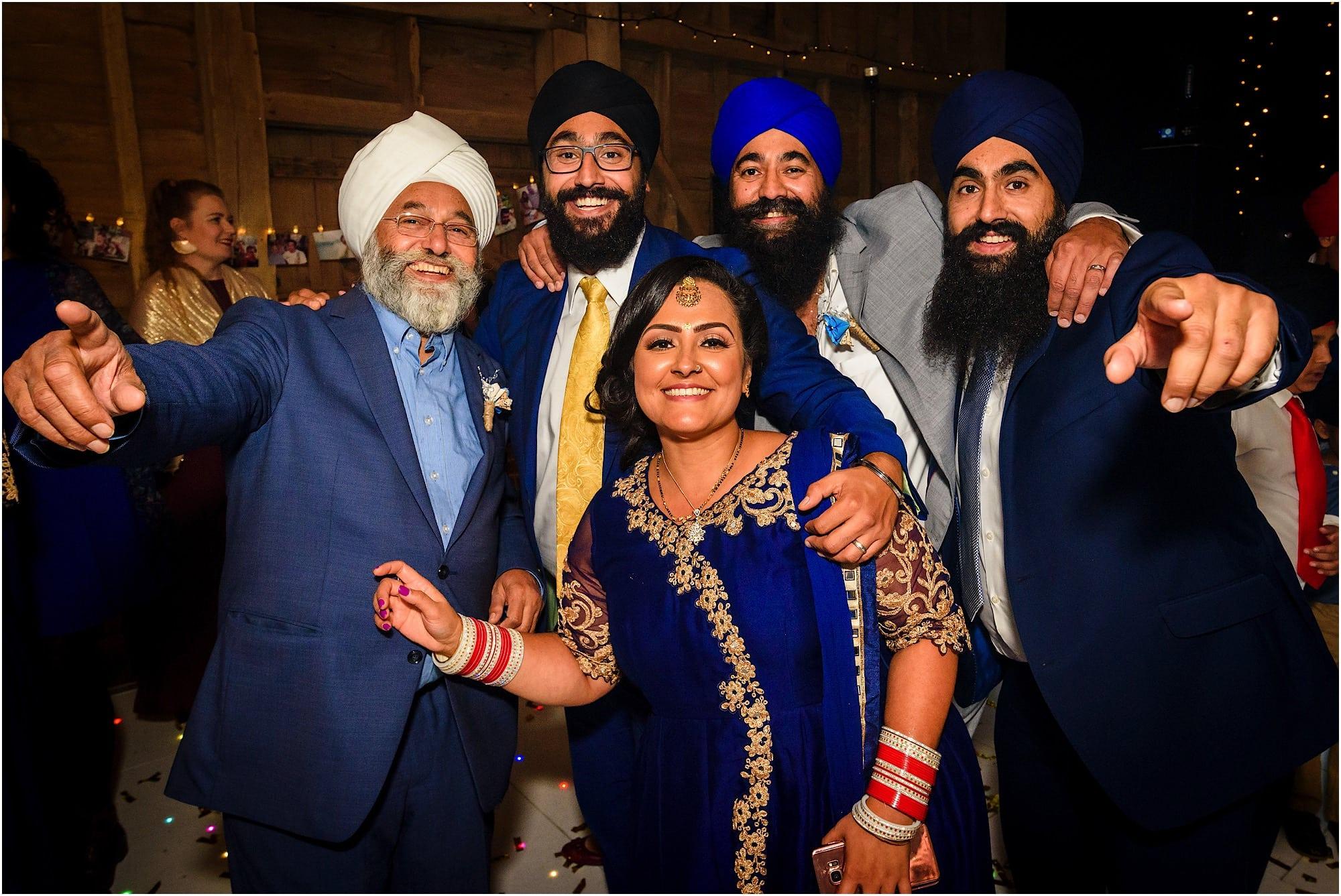 Sikh family group shot on the dancefloor