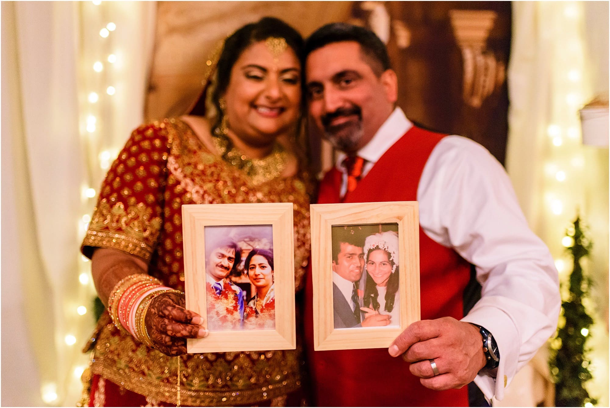 Parents of bride and groom in photo frames