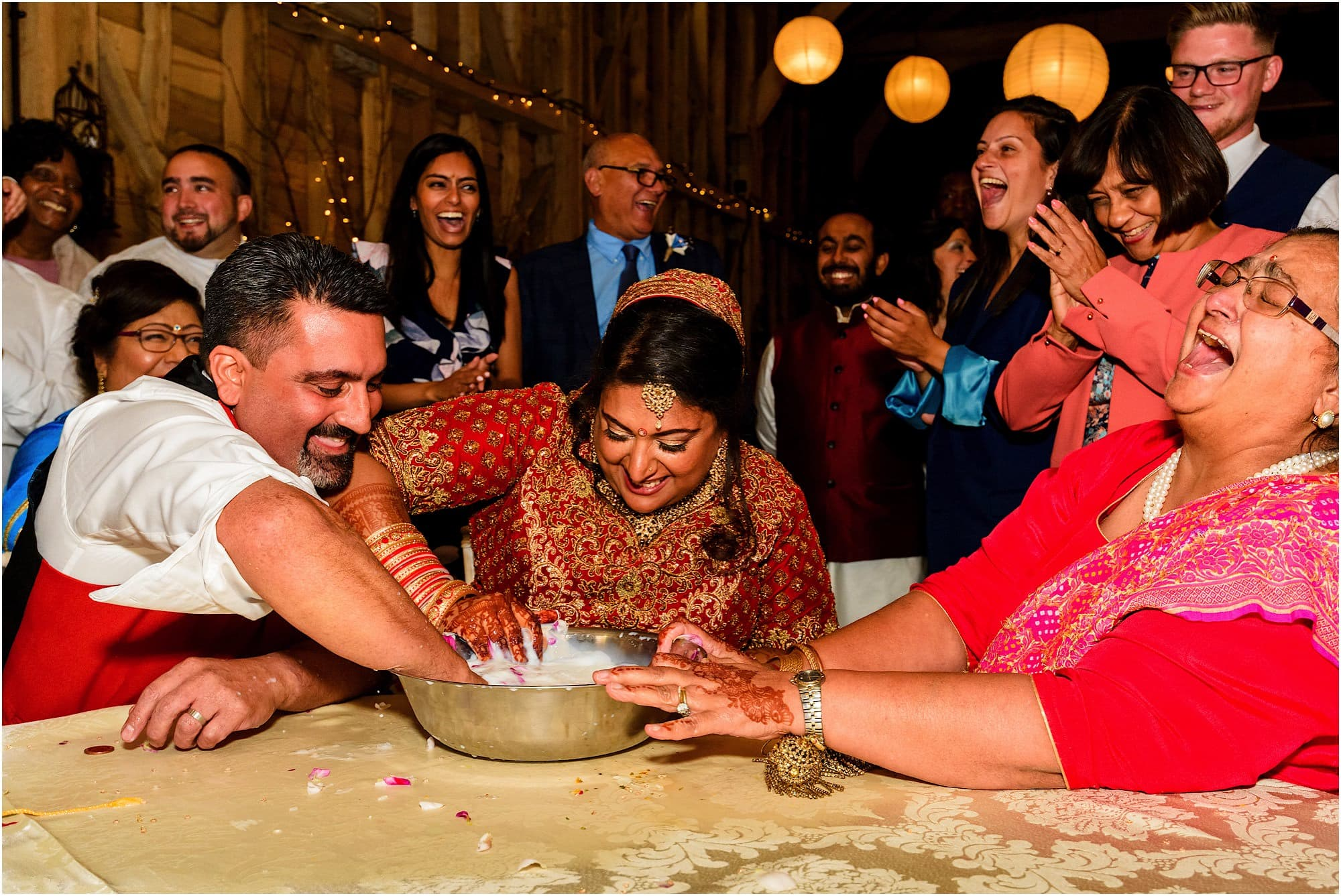 Bride and groom having fun playing a game