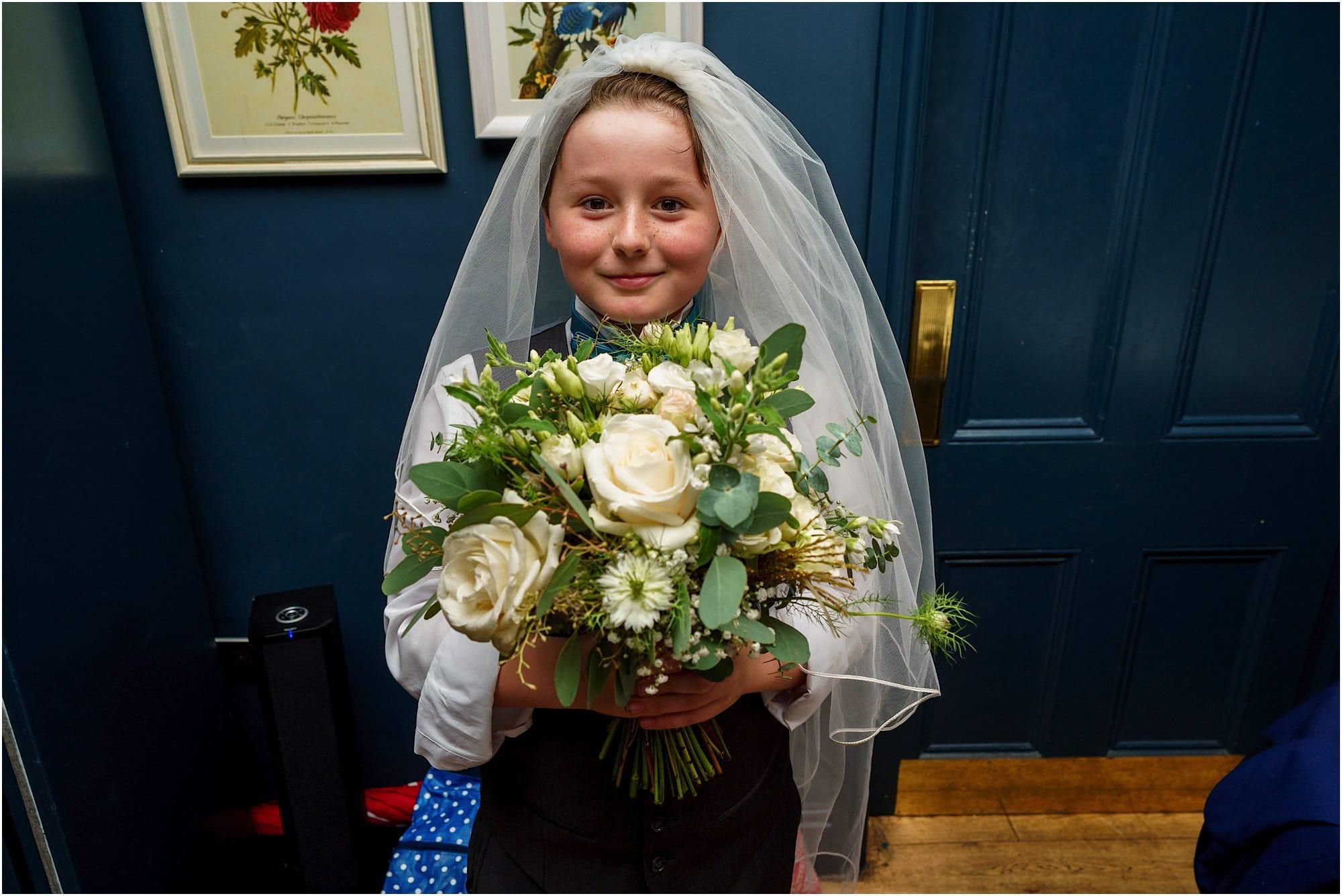 boy dressed as a bridesmaid