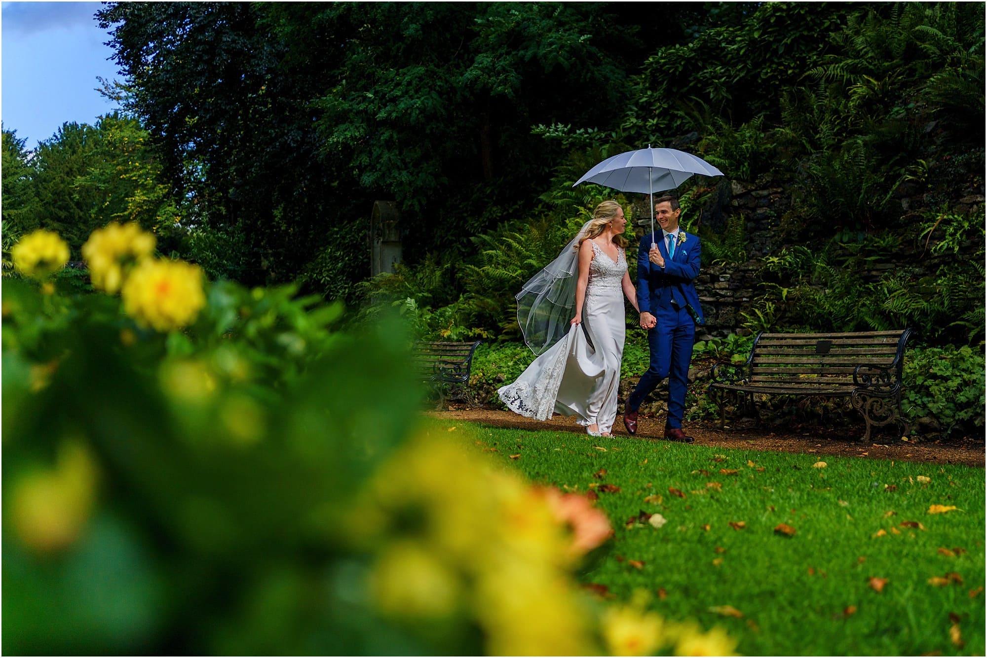 walking around the gardens with white umbrella